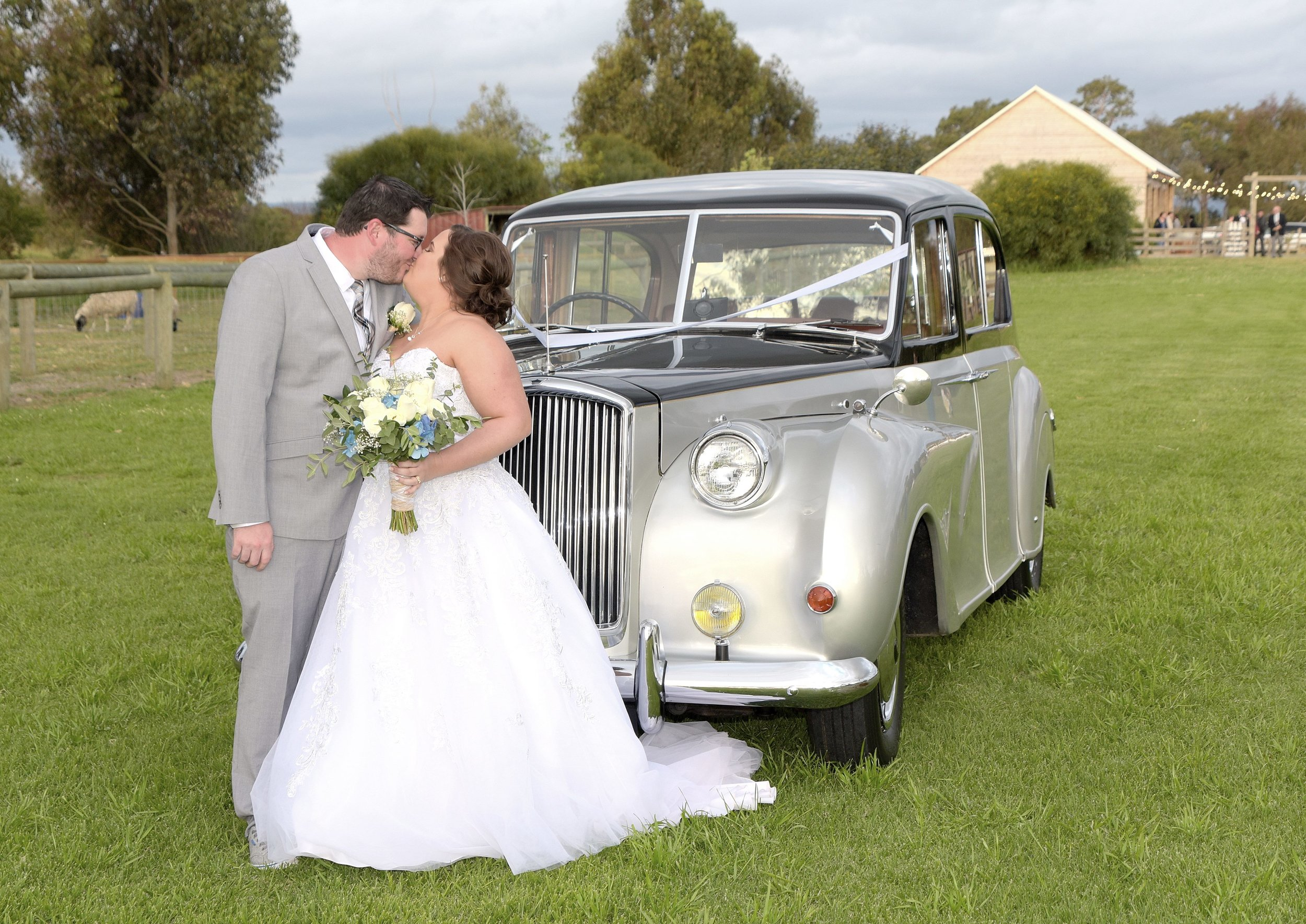 Amber & Aaron Baldivis Farm Stay bride and groom kiss in front of car again.jpeg