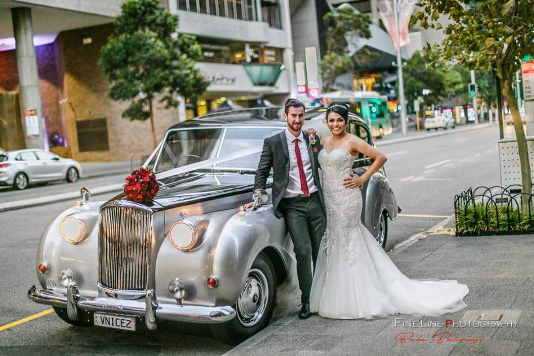 FineLine-Photography-Nicole-and-Peter-with-Very-Nice-Classics-wedding-car-with-flower.jpg
