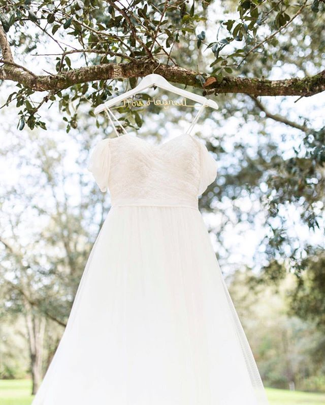 This dress was the definition of fairytale! Soft, flowy and it fit Alex like a glove! Also big thank you to the father of the groom who helped me hang this dress up because I was too short. 😂  Planner: @tara_lovelee  Florals: @weddingflowersjax  DJ: @islandsounddjs  Venue: @diamond_d_ranch  Desserts: @alleycakes  Linens: @beachview_event_rentals  Food: @whatsthecatchfoodtruck Bar: @aperfectpour • • • #bride #weddingdress #weddingday #groom #weddingphotography #bridal #weddinginspiration #weddingphotographer #bridetobe #weddings #instawedding #floridabrida #weddingideas #jacksonvilleweddingphotographer #engaged #weddingplanner #engagement #marriage #northfloridawedding #bridesmaids #floridaweddingphotography #theknot #weddinggown #weddingphoto #weddingplanning #weddinginspo #brides #bridesmaid #ido #instabride