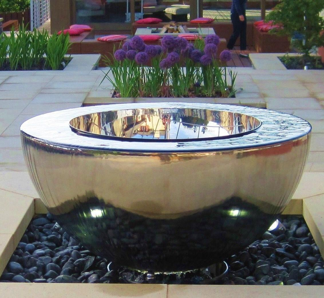A stainless steel water feature and sundial by David Harber Sundials