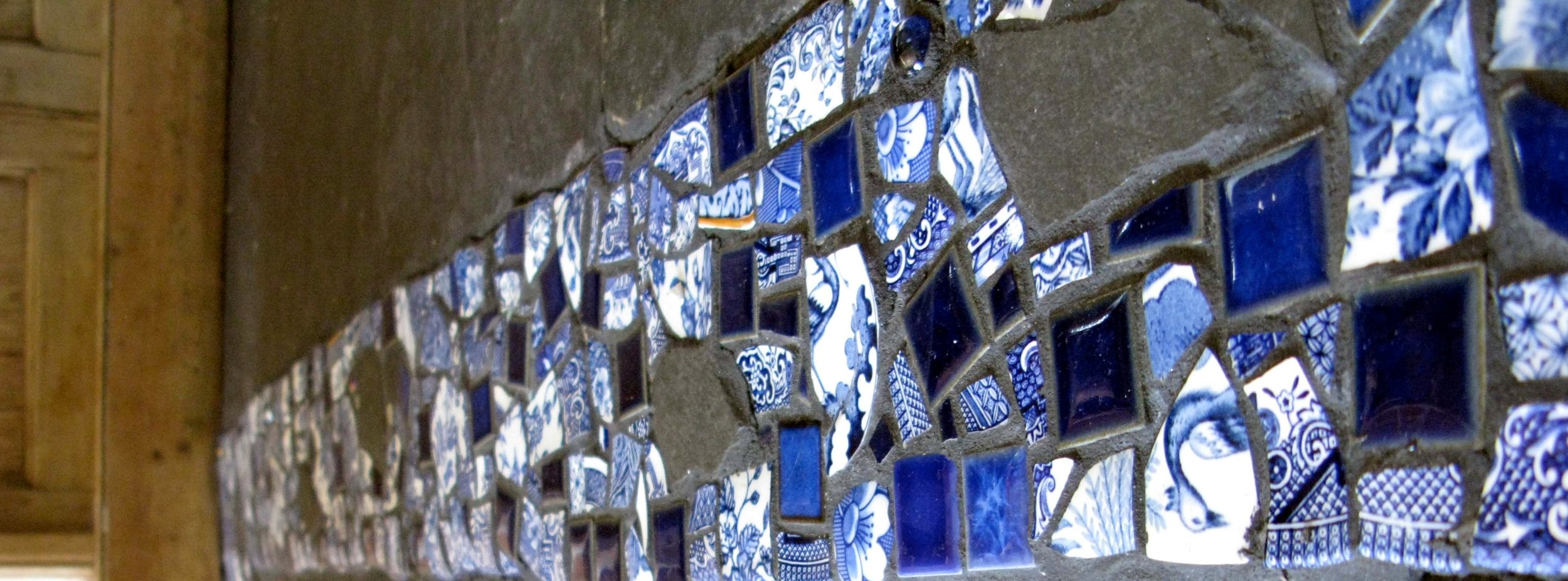 Mosaic floor inlay when a partition wall comes down ... recycled blue stoneware, ceramic and Welsh slate.
