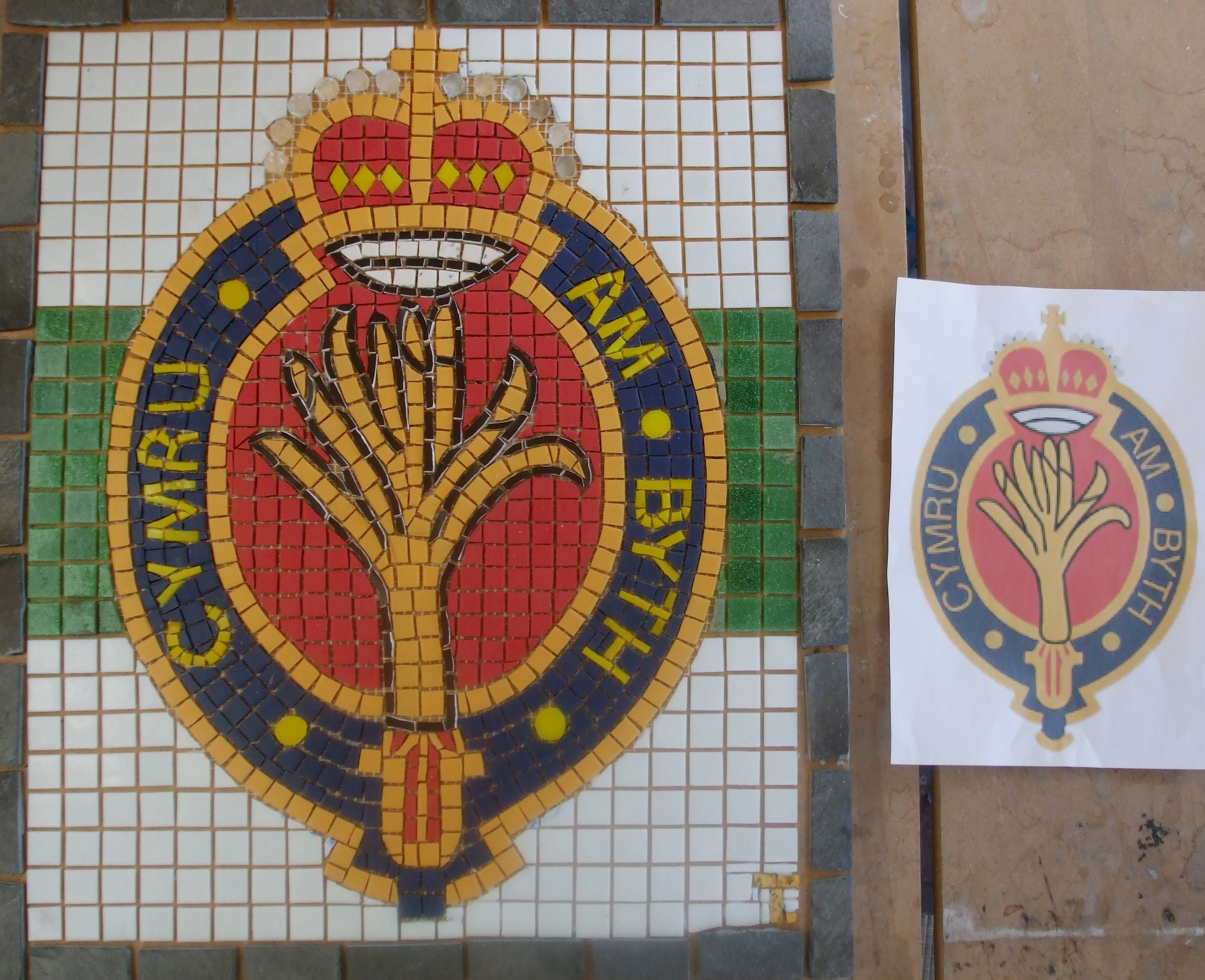 Badge of the Welsh Guards. Commission for the Regiment HQ at Pirbright, UK. Materials: Vitreous glass, matt porcelain, glass beads, Welsh slate, goldleaf glass