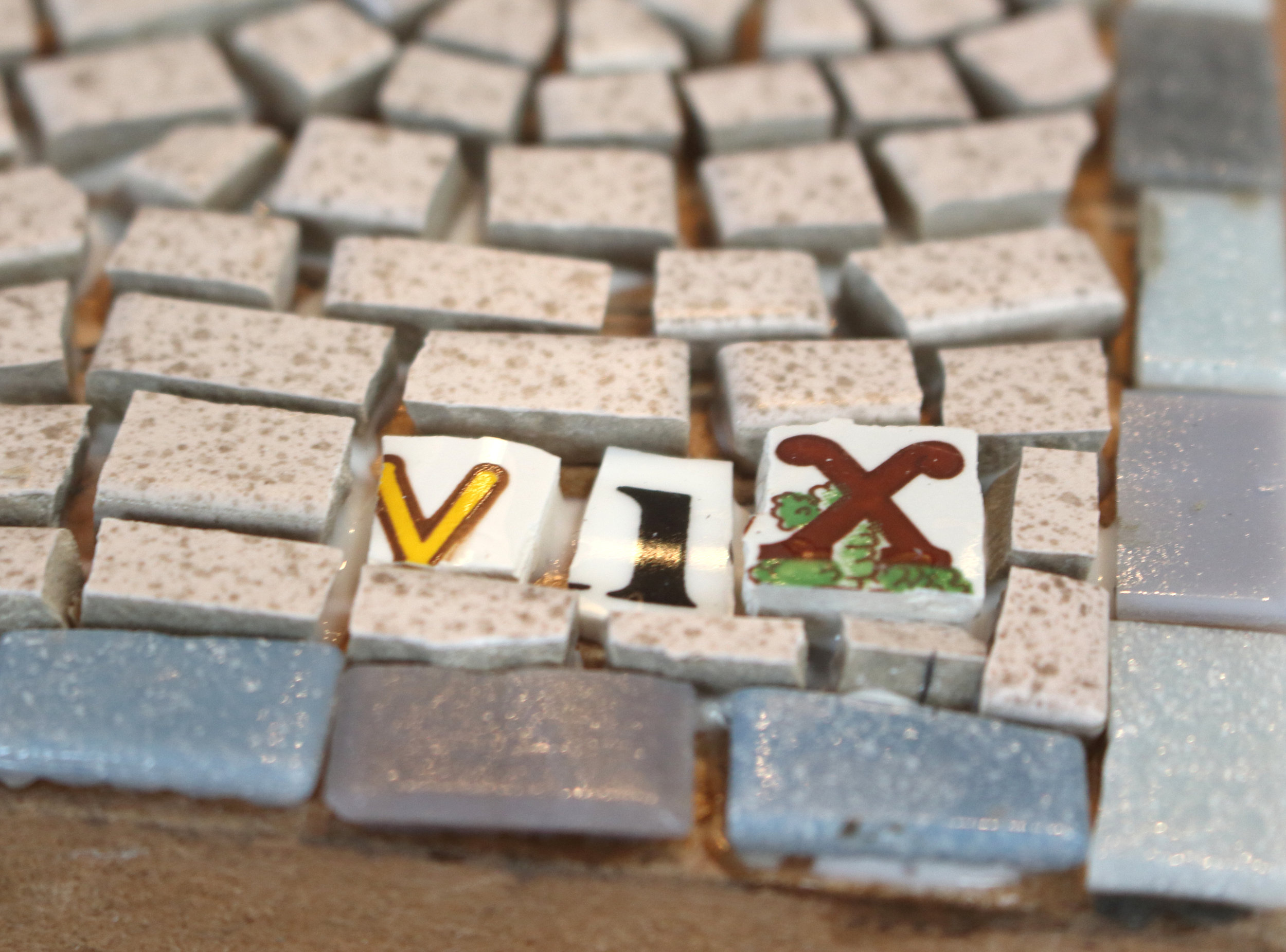 Personalise your mosaic with your initials cut from recycled crockery...