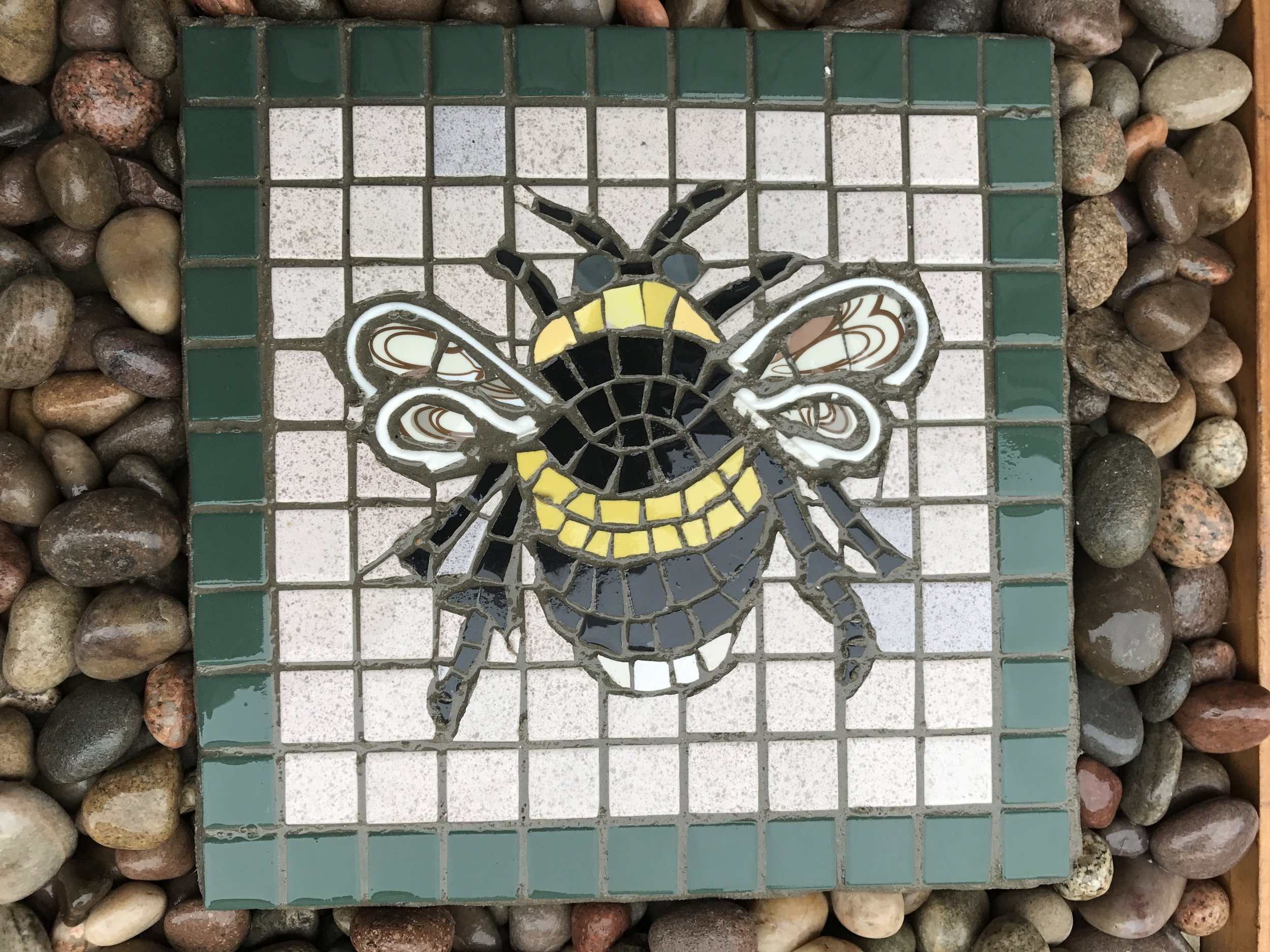 "Garden slab of the ""Manchester Bee""."