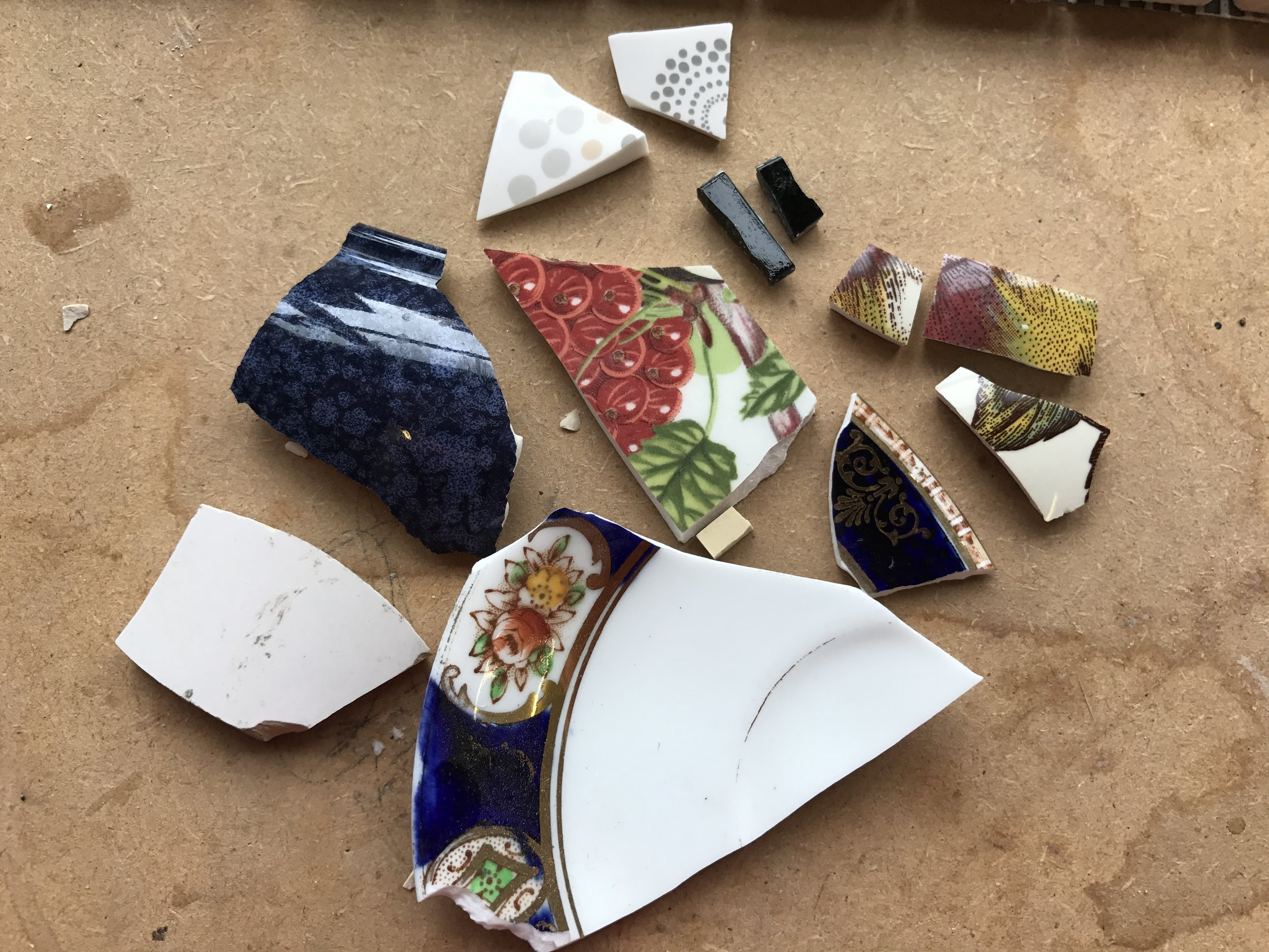 Broken china and porcelain ready to be recycled into a mosaic dragonfly.