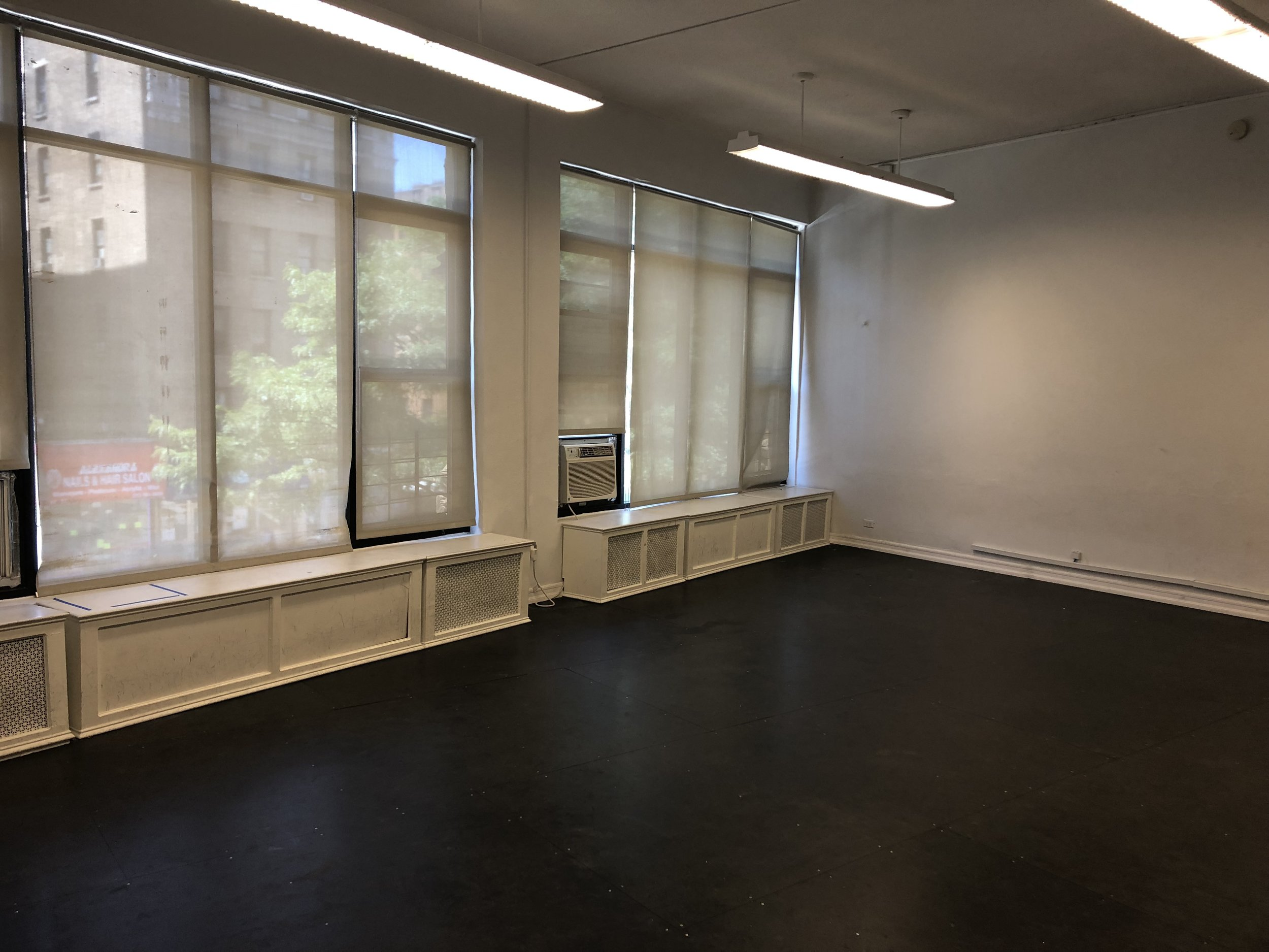 Classroom 1 - An intimate studio ideal for table reads, workshops, and meetings, as well as vocal, drama, tap, & other dance forms.MEDIUM: Approx. 23'x22'Black Masonite Floor, High Ceilings, White Walls, No Mirrors, Window A/C Unit, Near Restrooms, Speakers Upon Request, Keyboard Upon Request, Free Wifi, Tap Shoes OKIndividual Artist: $10/hr*Artist Classes: $15/hr*Non-Profit: $15/hr*For-Profit: $25/hr*