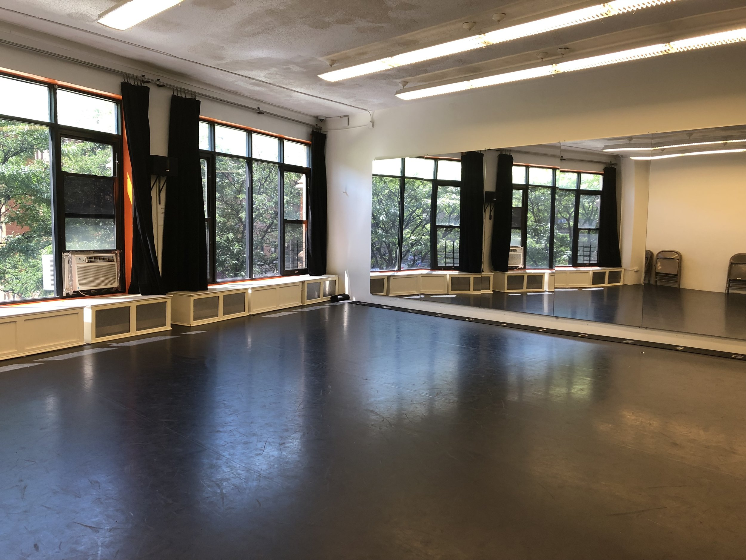 Studio 1 - A versatile space located adjacent to the Reception Room; perfect for small rehearsals, classes, photo shoots, and auditions.MEDIUM: Approx. 25' x 27'Sprung Black Mezzafloor, High Ceilings, White Walls, Window Blackout Curtains, 1 Wall of Mirrors, Window A/C Unit, Bluetooth Speaker w/ Aux, Portable Ballet Barres, Keyboard Upon Request, Free Wifi No Tap ShoesIndividual Artist: $15/hr*Artist Classes: $20/hr*Non-Profit: $25/hr*For-Profit: $35/hr*