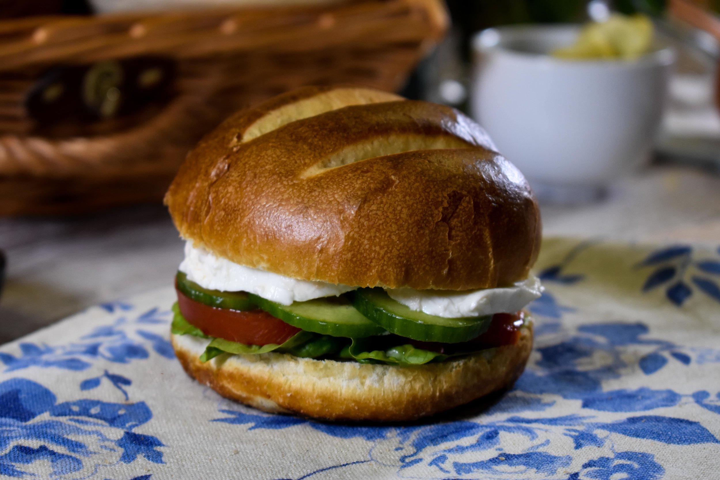 Pretzel bun with lettuce, cucumber, tomato and mozzarella