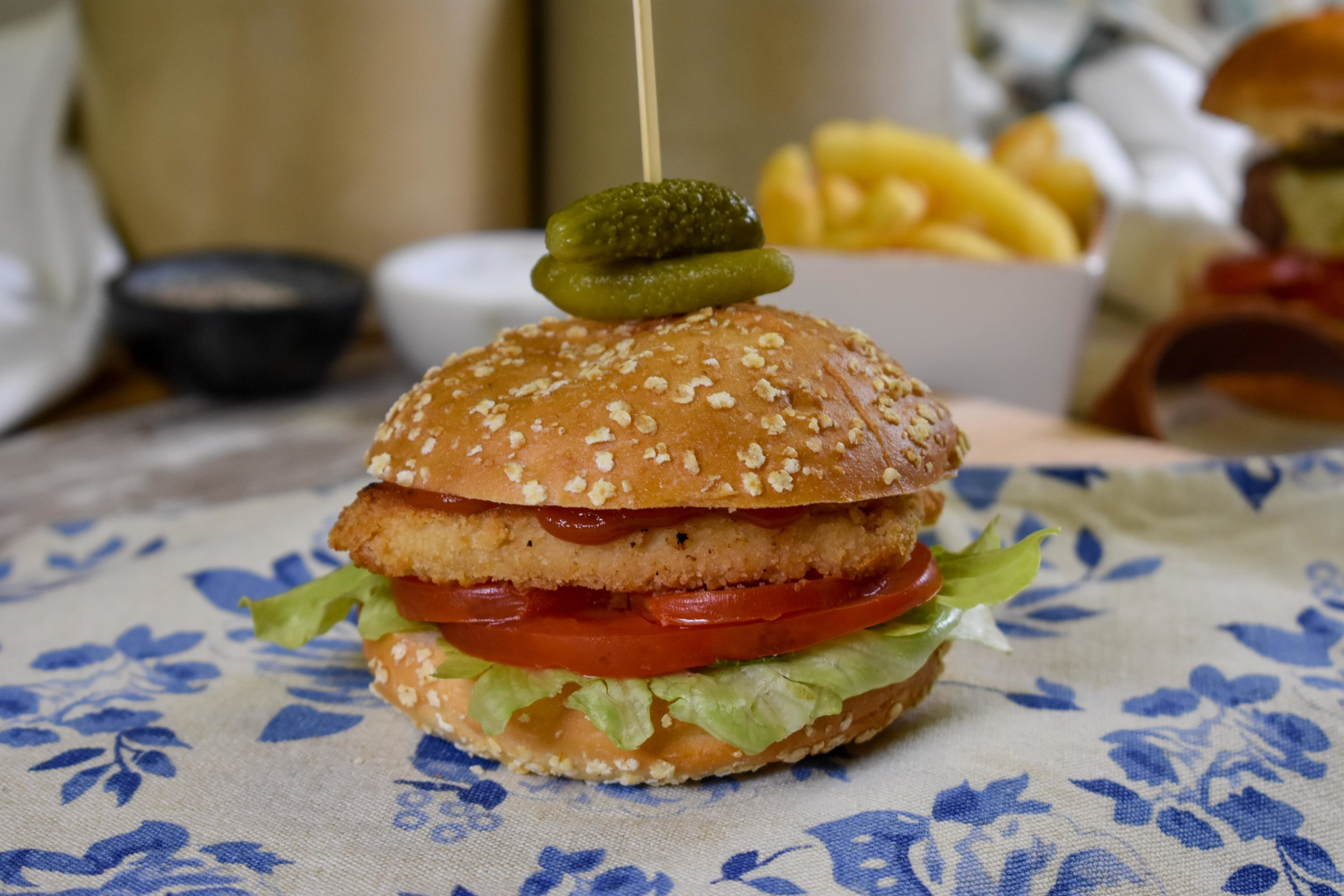 Gluten free bun filled with lettuce, tomato, chicken goujons and topped with ketchup