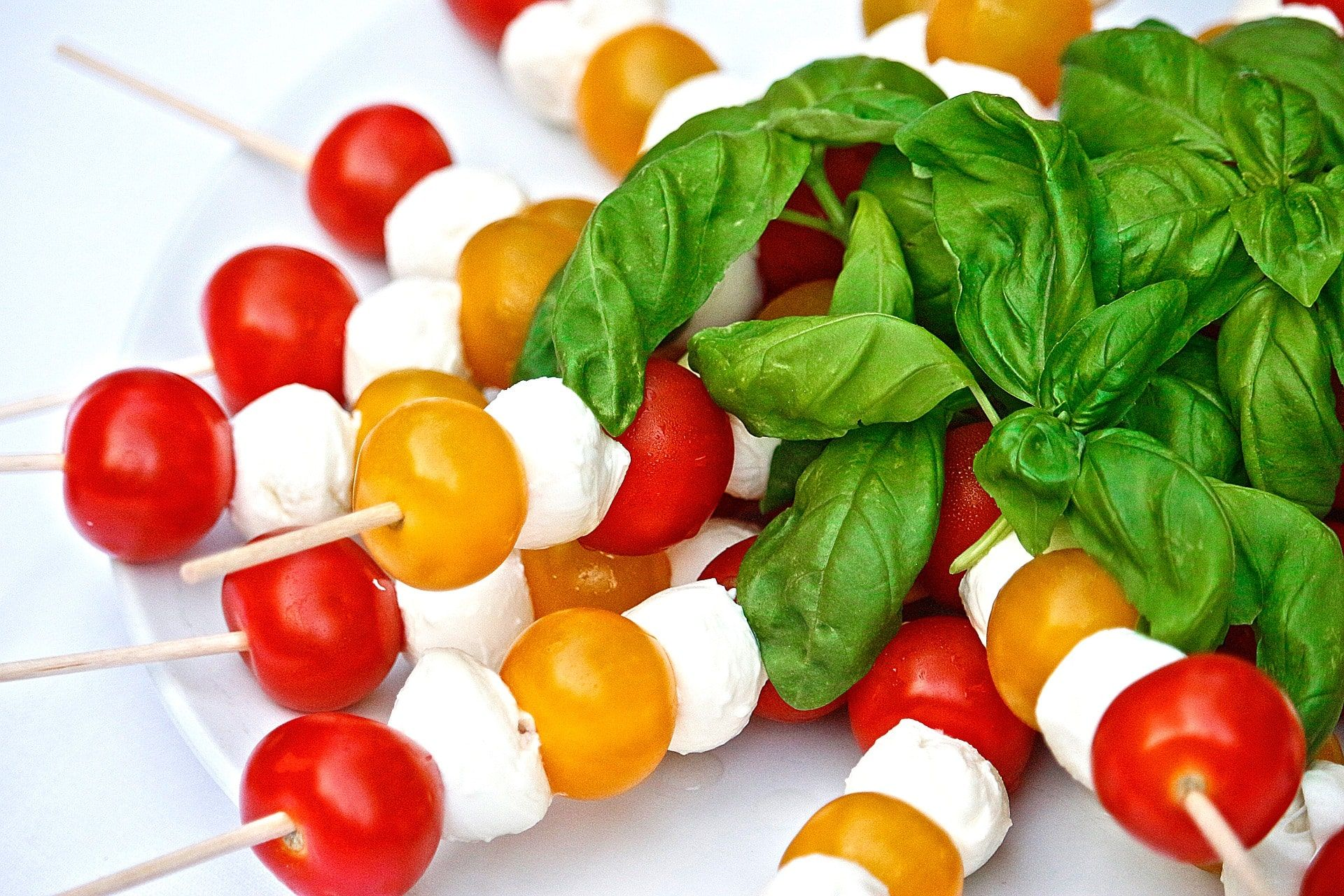 caprese salad - Caprese Salad is an Italian classic and a loved flavour combination, but salads can be a little annoying to take to a picnic, which is why these two recipes are perfect.Tablespoon's Hasselback Tomato Caprese means you can get a mouthful of tomato, mozzarella and basil with every bite, they can also be eaten with your fingers so no need for knives and forks! You could size these down with smaller ingredients to make them easier for children.Another easy and simple way to have a Caprese salad is to put them on skewers! This recipe from Good Housekeeping gives all the ingredients you will need.