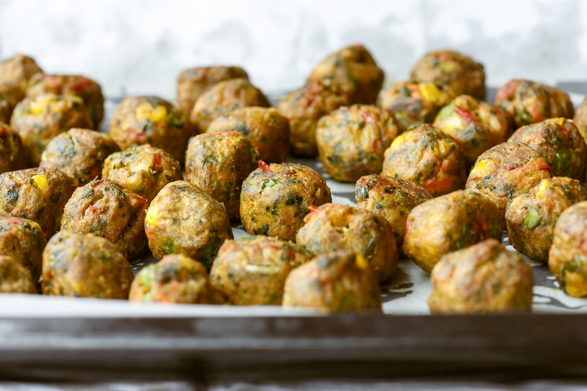 VEGGIE balls - These would be a great accompaniment to a salad or as a side. These balls are made out of halloumi and carrots, seasoned and then deep fried. Recipe from Olive Magazine.