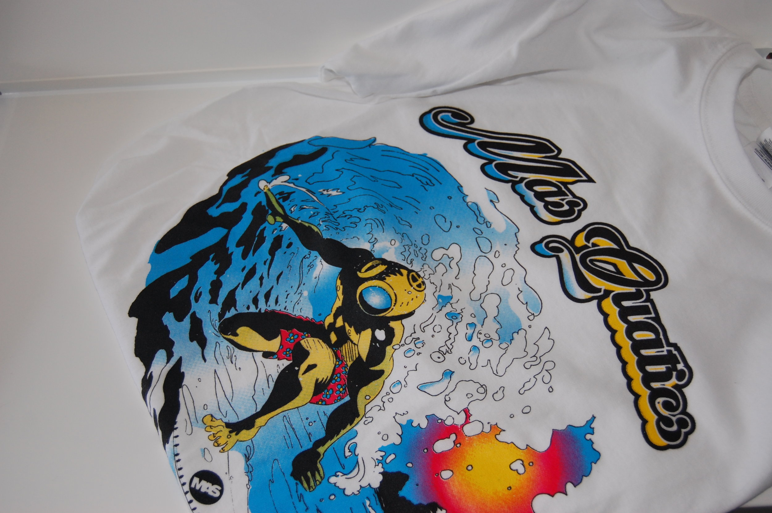 "MASQUATICS SHIRT   Our newest summer line ""Mas Quatics"". This print was achieved using halftone overlays.  In the center of the design, the 2-tone character, the Diver Surfer,  inspired by 80's and 90's surf art styles and the art of Jim Phillips, and R. Crumb.  The design began with a hand drawn illustration, followed by a live trace to digitally render it, opting for a live trace rather than a digital recreation to preserve a hand-drawn feel."