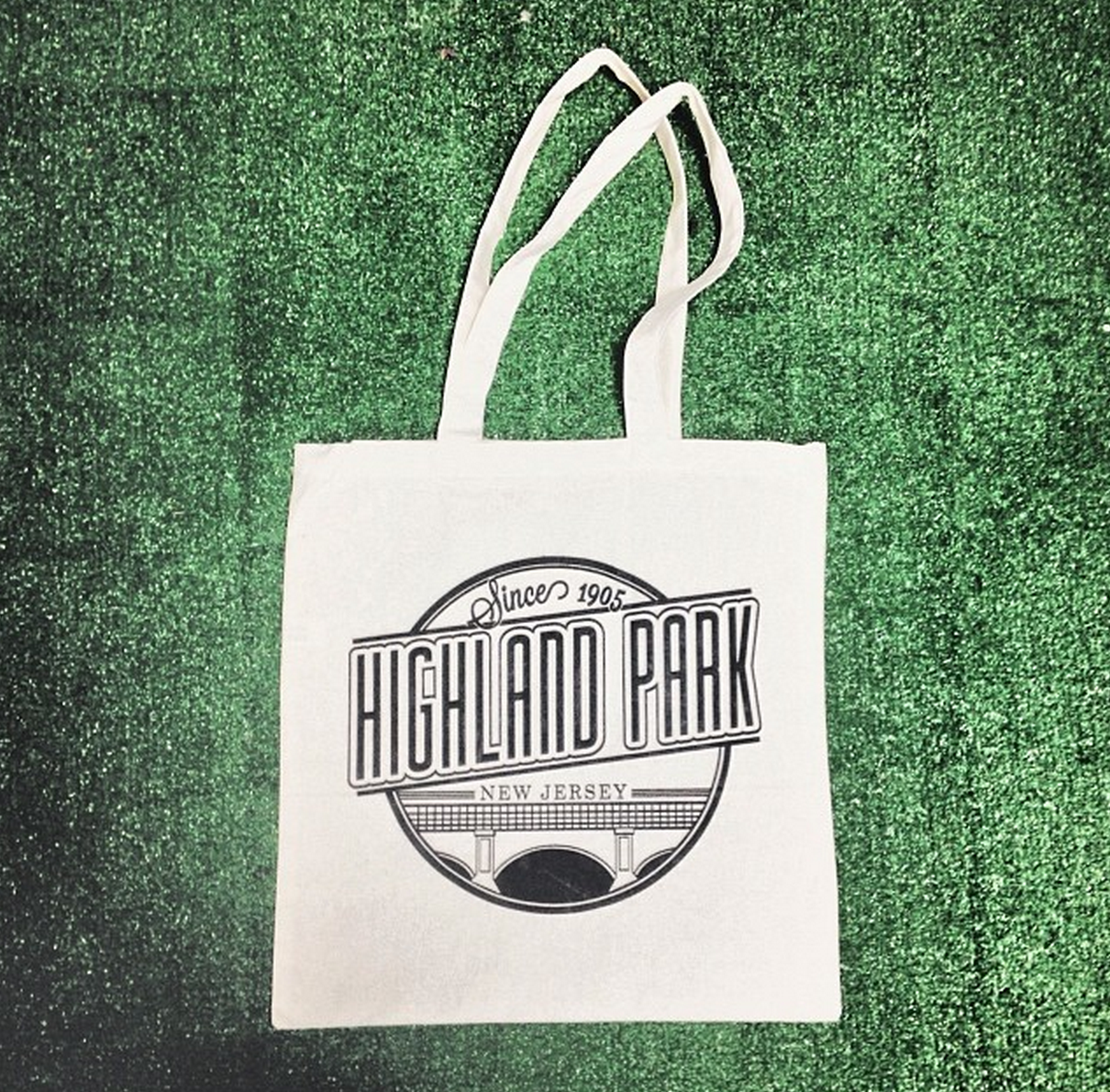 HIGHLAND PARK TOTE BAG   We created the Highland Park logo to pay homage to Highland Park, NJ's roots as a turn of the century town built on the heels of industry. Its classic design has proven to be a favorite to Highland Park residents, and is always being printed on your new favorite tee/hoodie.  We offer the same bags in a variety of colors for custom print jobs!