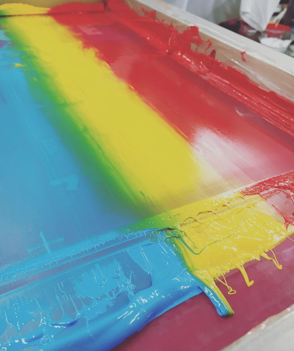 RAINBOW SCREENPRINT   Set yourself aside with some special ink effects. Our super talented manual pressman are capable of some really cool printing techniques. This print was composed of three plastisol ink colors, which were applied to our screen and smeared together to create the affect of a rainbow. The blending of colors intensifies as the print goes through production and every piece has slight variations in color