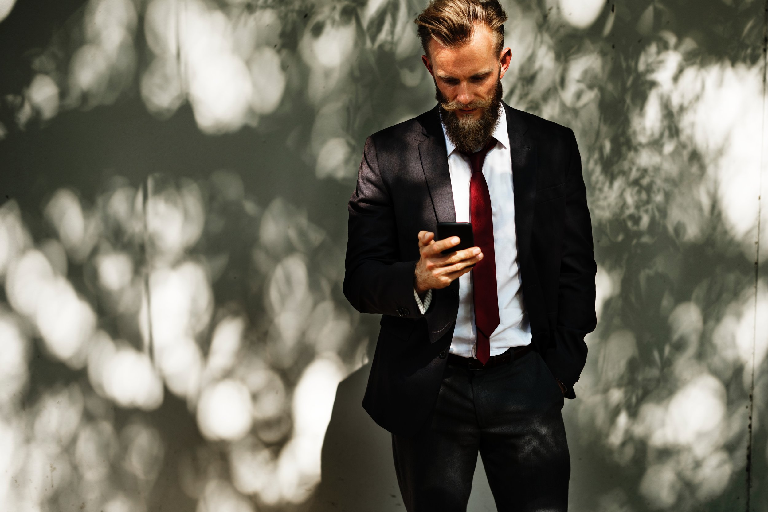 Man in suit with smart phone.jpg