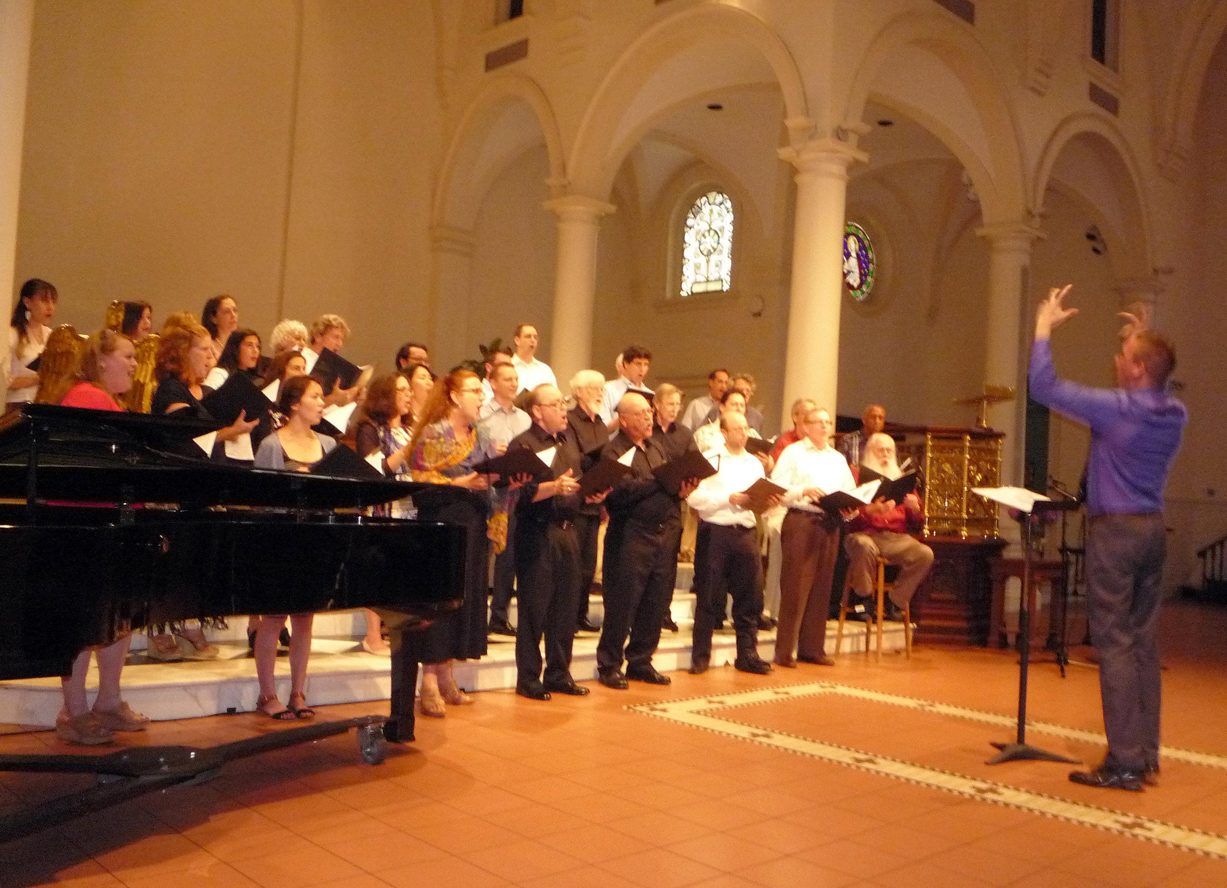 Matthew Oltman conducts the William Appling Tribute Chorus