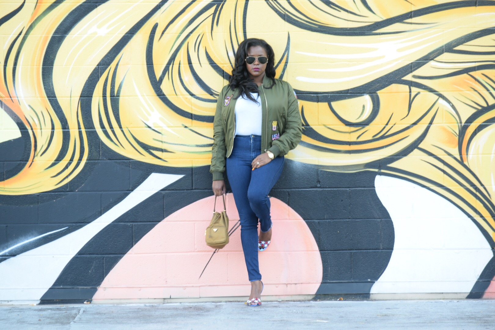 TopShop Bomber (similar  here ), TopShop t-shirt ( here ), TopShop Raegan heels ( here ), American Apparel Easy Jeans ( here ), Prada Clutch (old, but I love this  one ), RayBan Aviators ( here )