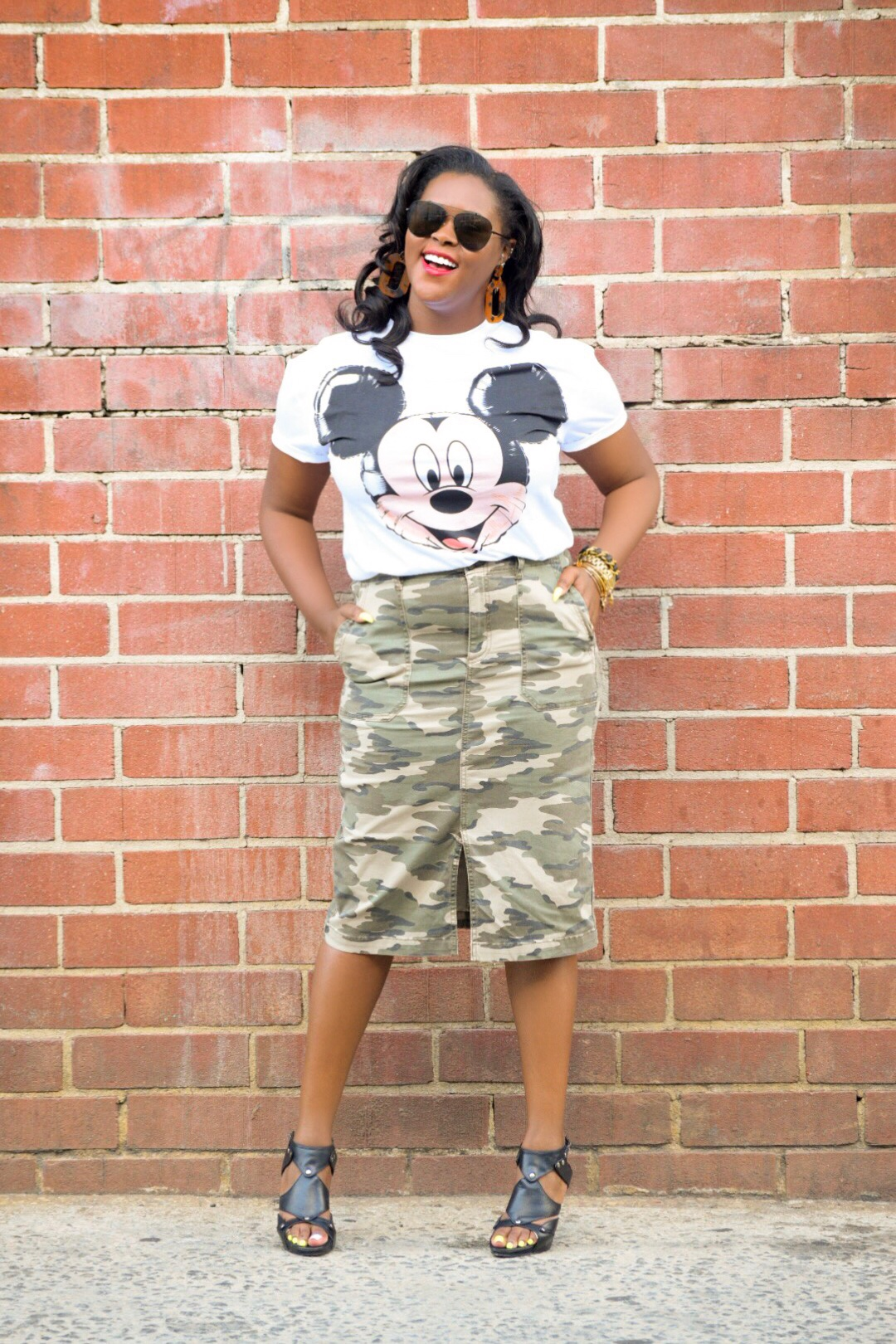 Zara Mickey  T-Shirt , Carlson  Skirt  (currently on sale during the Nordstrom Anniversary Sale), H&M Earrings (sold out), Steve Madden Heels (old)