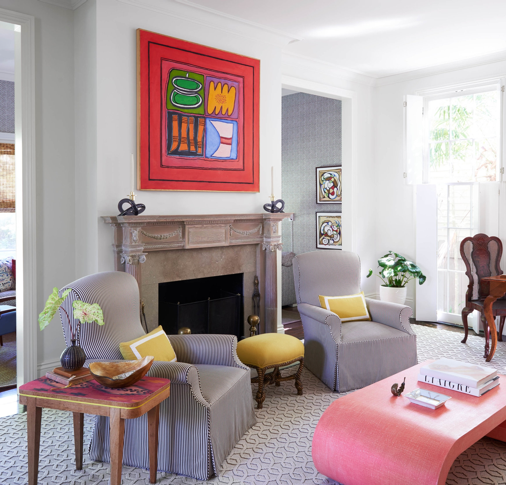 Swivel chairs face a custom-glazed Karl Springer coffee table beneath a painting by the Louisiana artist Ida Kohlmeyer in the Massengale family's living room.