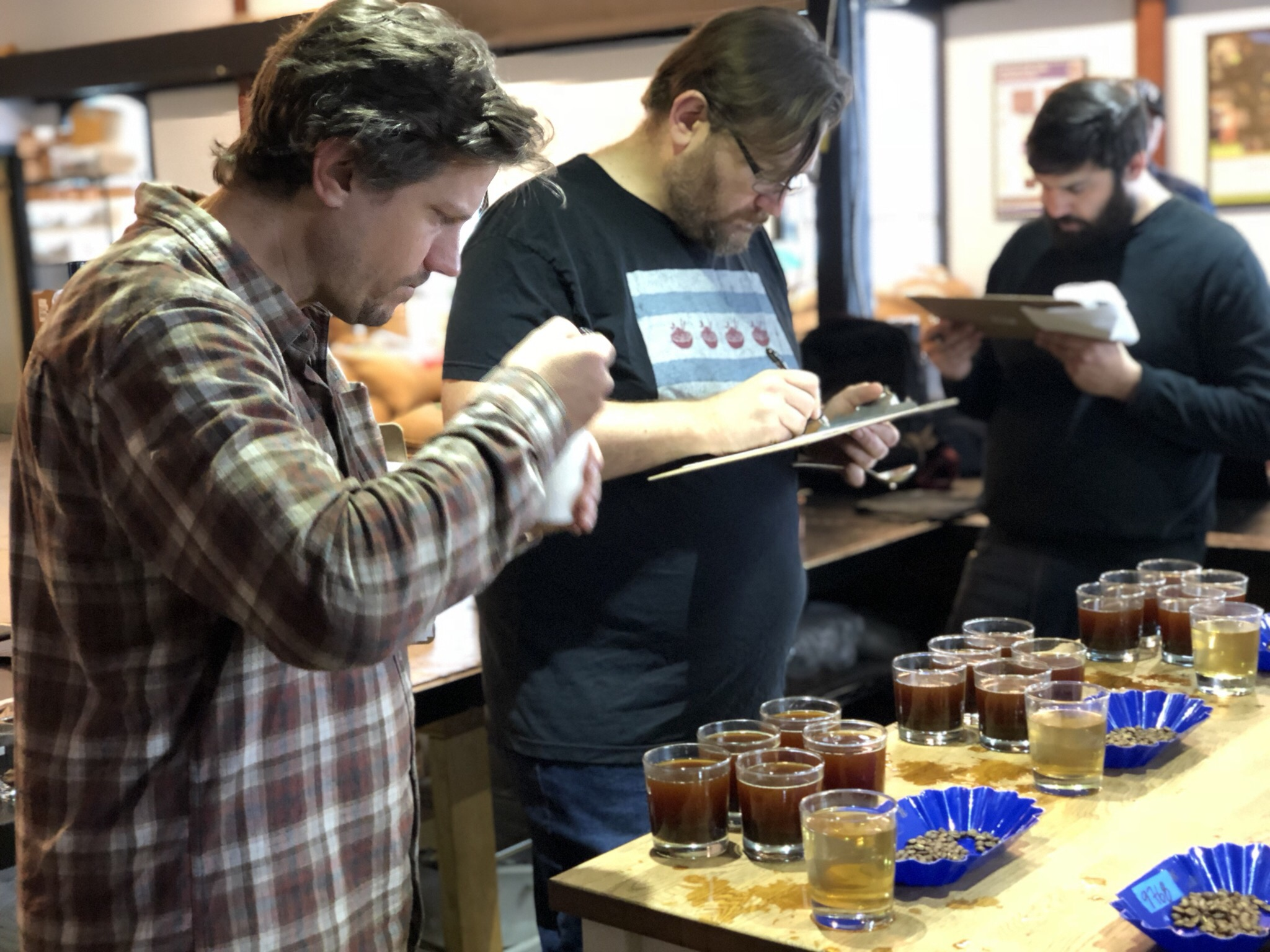 The Little City team cupping Costa Rica samples from Ian's sourcing trip, to determine which freshly harvested (seasonal) coffee will replace the Peruvian coffee in some of our blends.