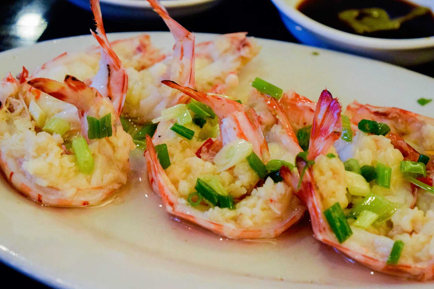 Shrimp topped with scallion and minced garlic