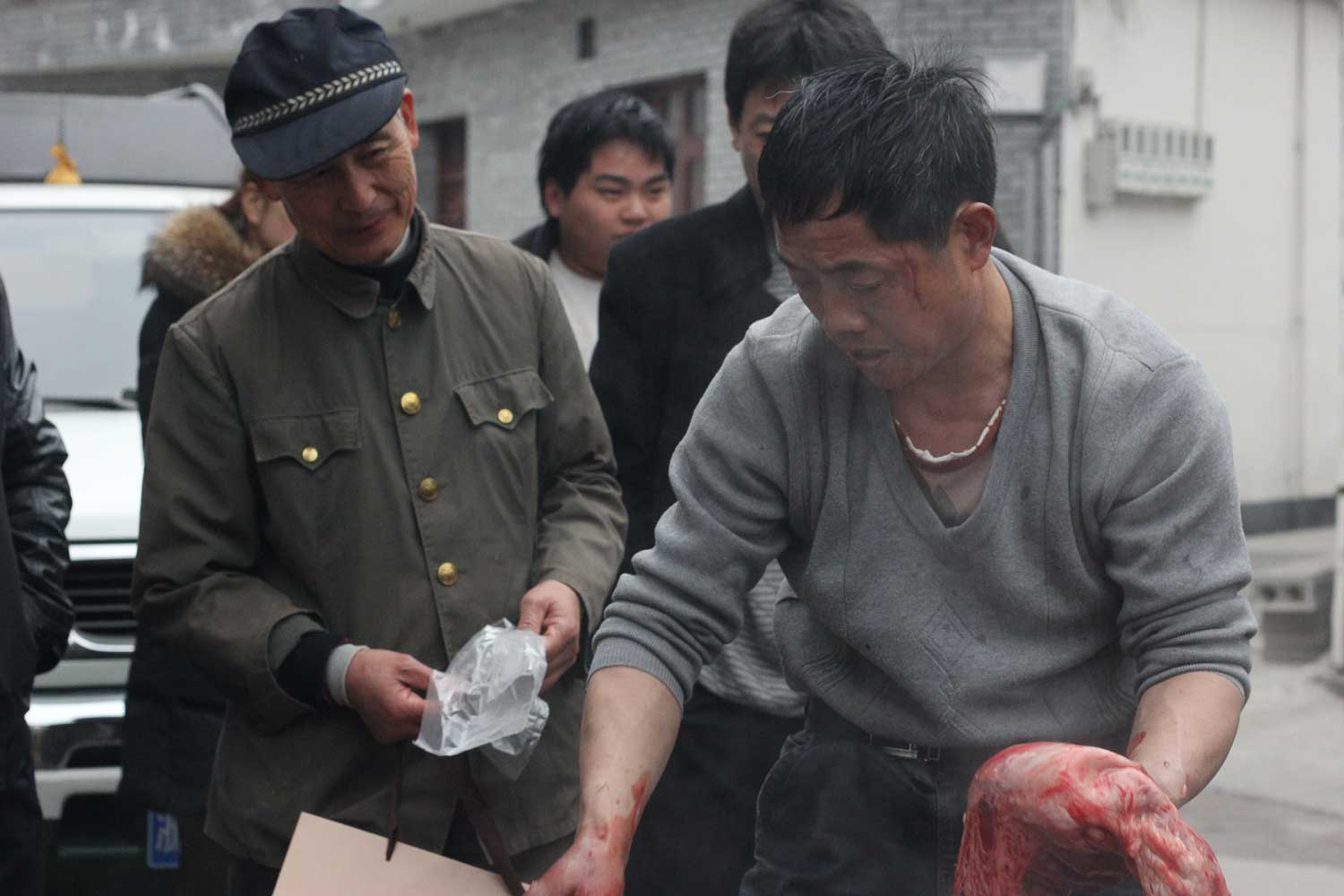 """""""The meat is broken down and distributed.A set of ribs might go to a family, but as in all Chinese cooking, this will be shared in the center of a table. The ribs are separated and then each bone is crushed into so many little squares – faster to cook, requiring less fuel, and easier to share."""""""
