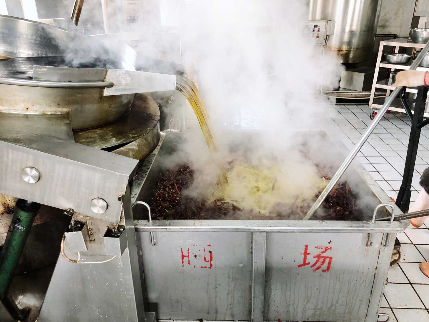 """""""A mechanical lever lifted the cauldron and the oil began to flow. It hit the ingredients with a sizzle and a cloud of chillies began to fill the room and our lungs."""""""