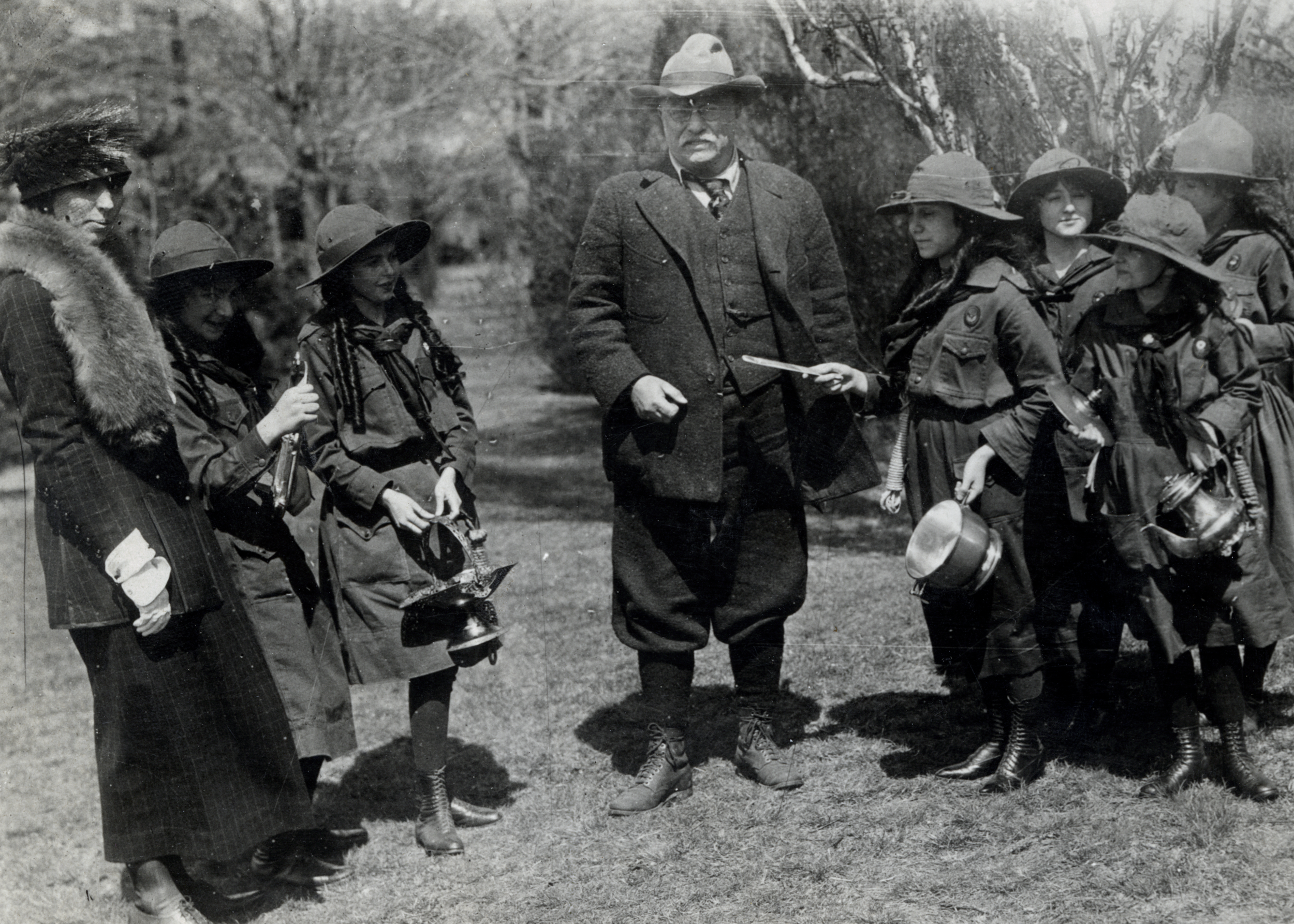 """""""Colonel Roosevelt giving his family silver to the Girl Scouts to be melted and the proceeds used to buy comforts for the soldiers,"""" 1918. Photo courtesy of the Theodore Roosevelt Birthplace National Historic Site."""