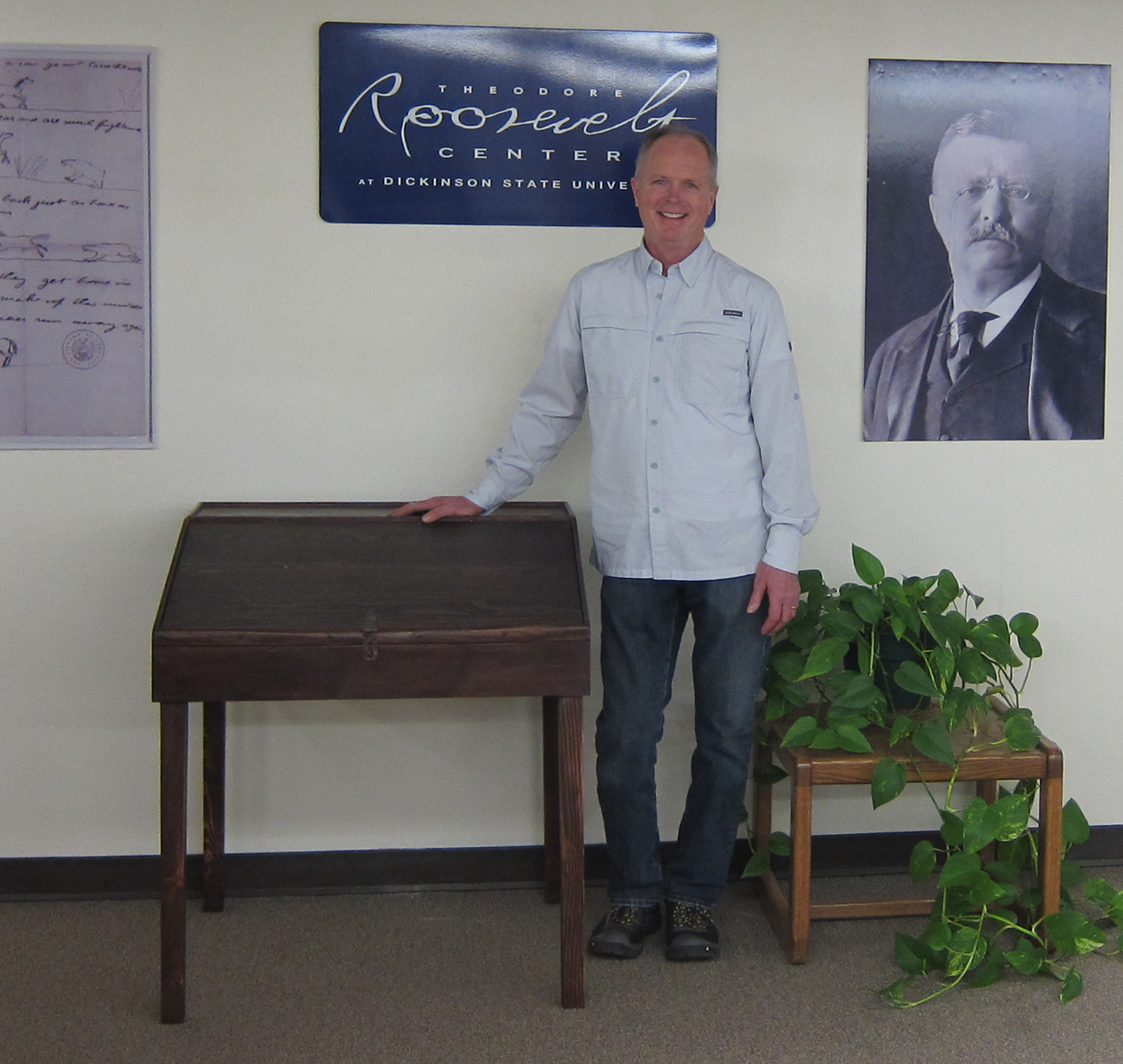 Duey Marthaller stands by the desk he handcrafted and recently donated to the Theodore Roosevelt Presidential Library. It is an exact replica of the writing desk at which Theodore Roosevelt sat and wrote parts of four books and countless letters home during his mid-1880s sojourn in the badlands of Dakota Territory.