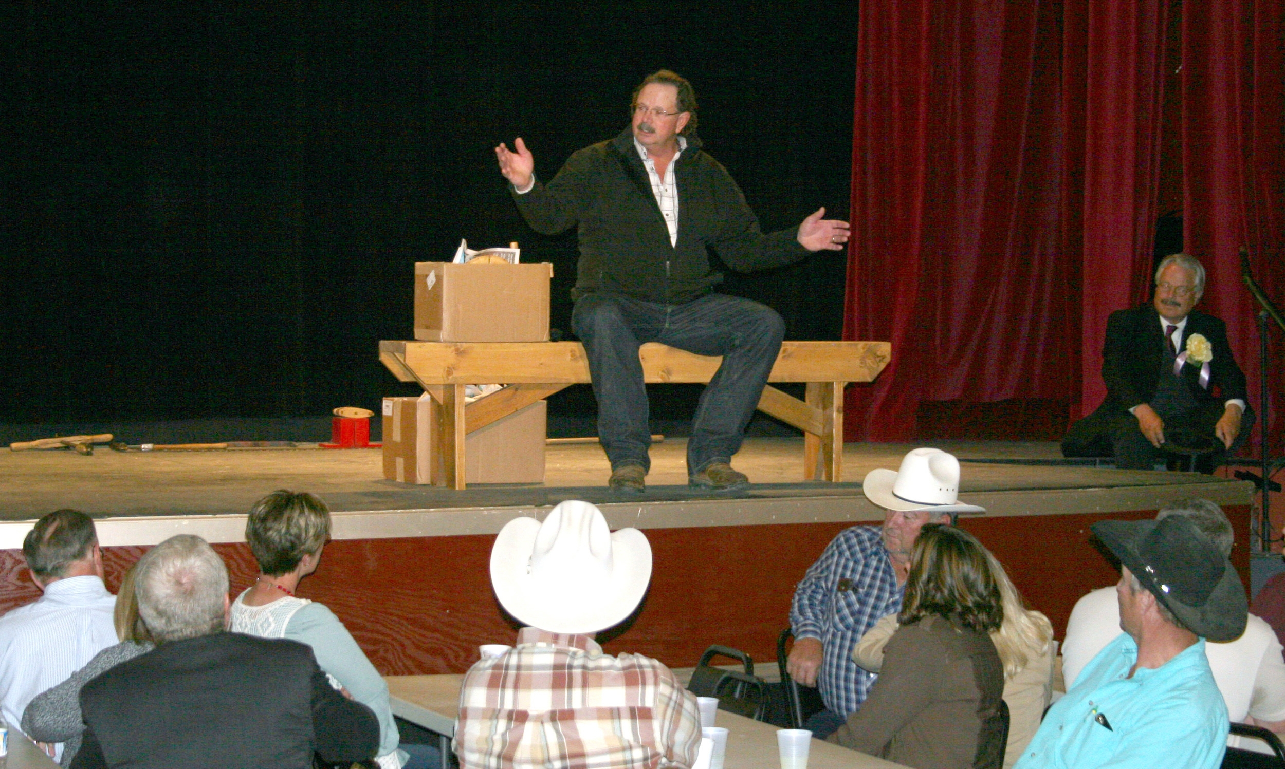 John Hanson shares anecdotes about harvesting cottonwood logs with the ranchers who donated them at the rancher appreciation event held in September 2017.