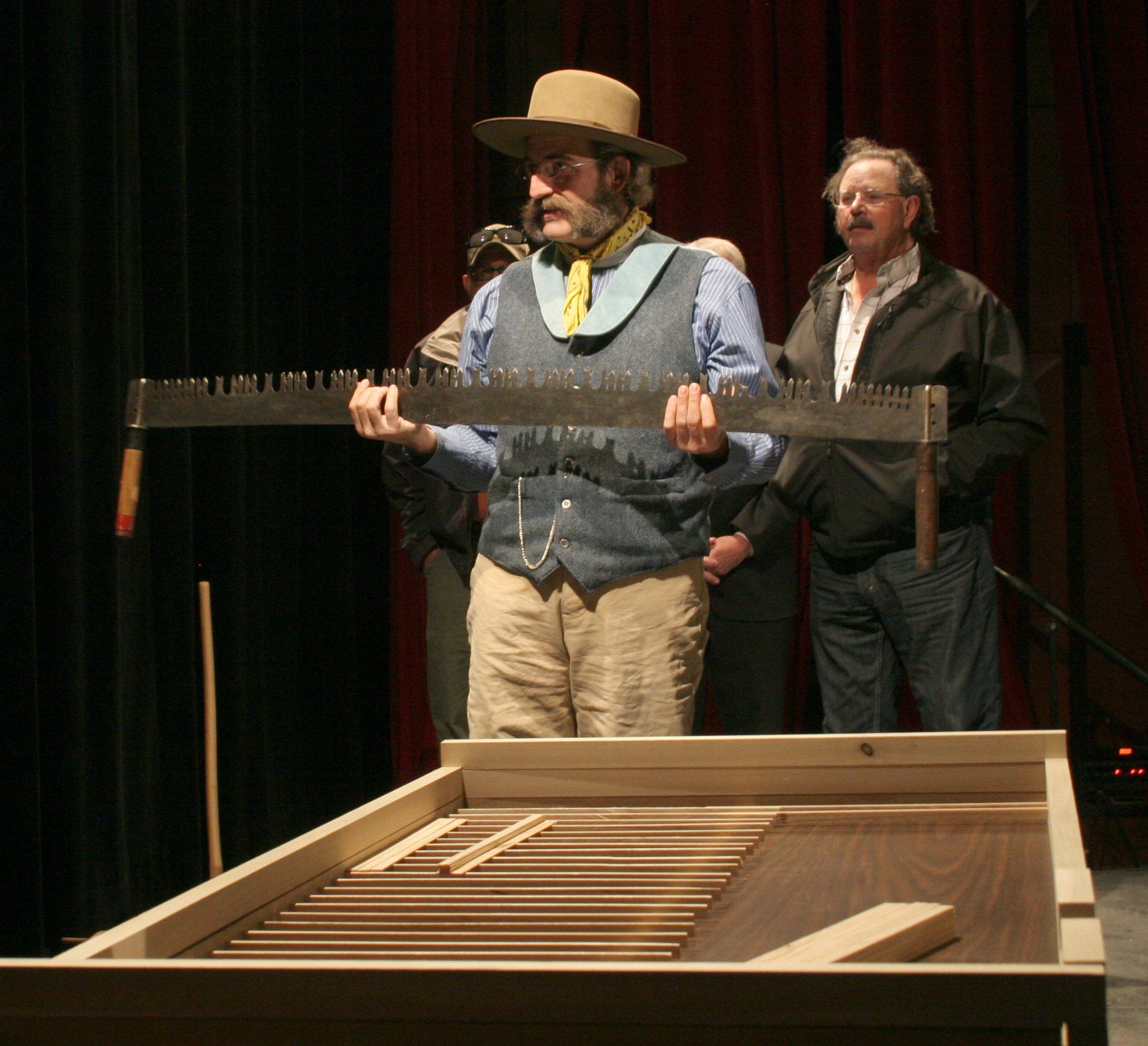 Master Builder Richard Bickel explains the type of tools that were used to build the original Elkhorn Ranch Cabin and that he and his crew will use to build the replica at the TRPL.