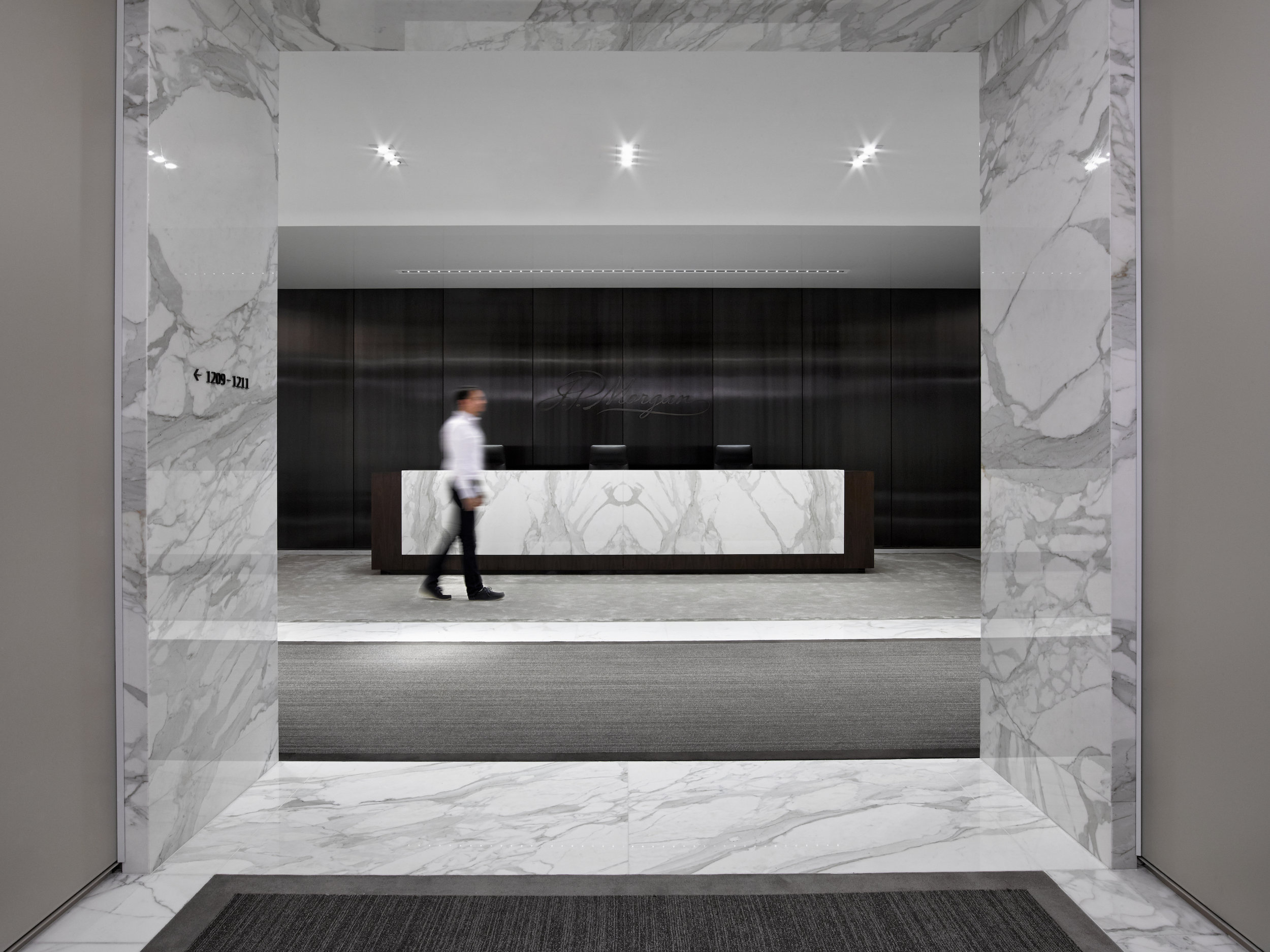 Chase: Wealth Client Management   Floors and walls, on reception and elevator lobby. Calacatta gold, and ¾ inch slab Material.