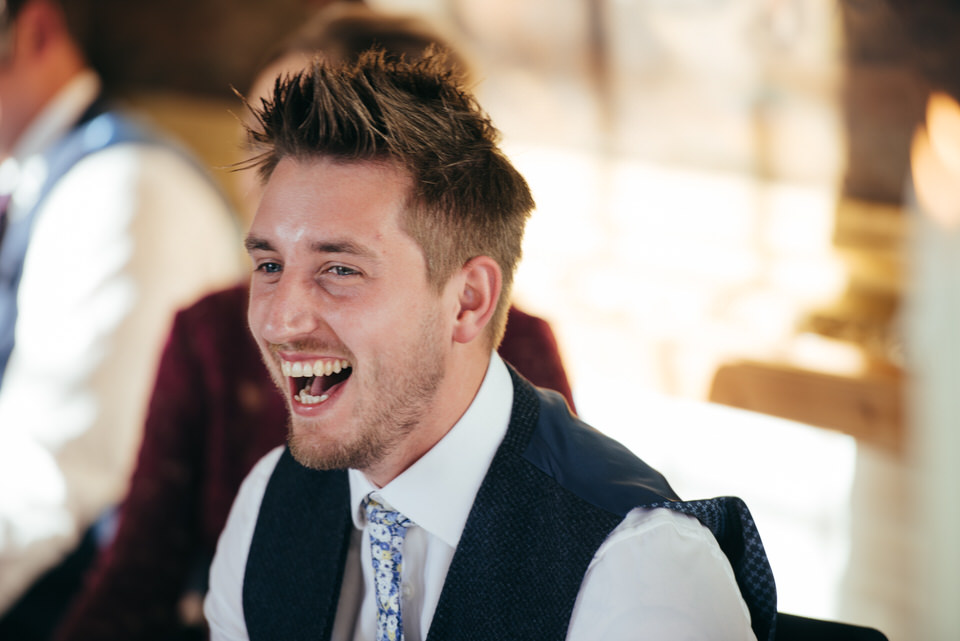 Candid laughter at wedding