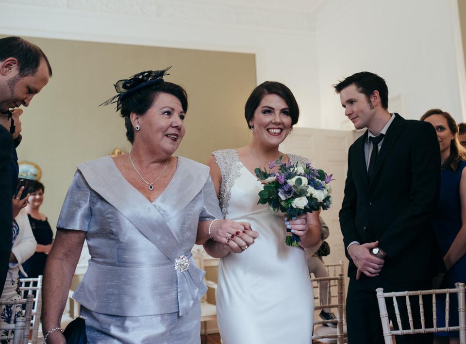 Mother giving bride away