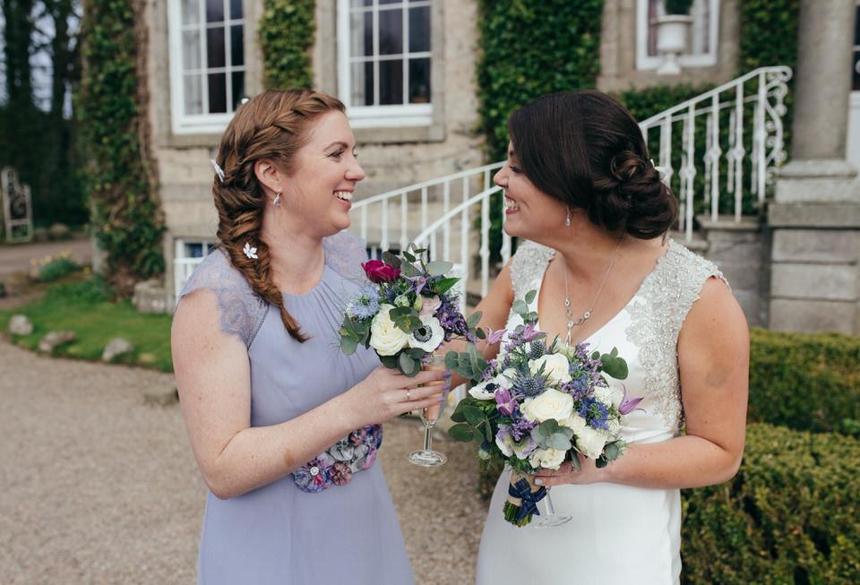 Bride and bridesmaid laughing