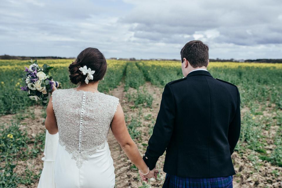 Wedding portraits rapeseed field