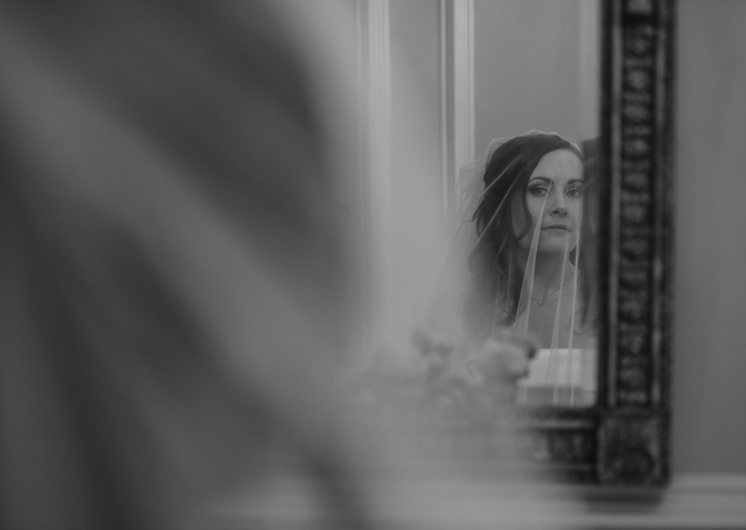 Bride looking into the mirror