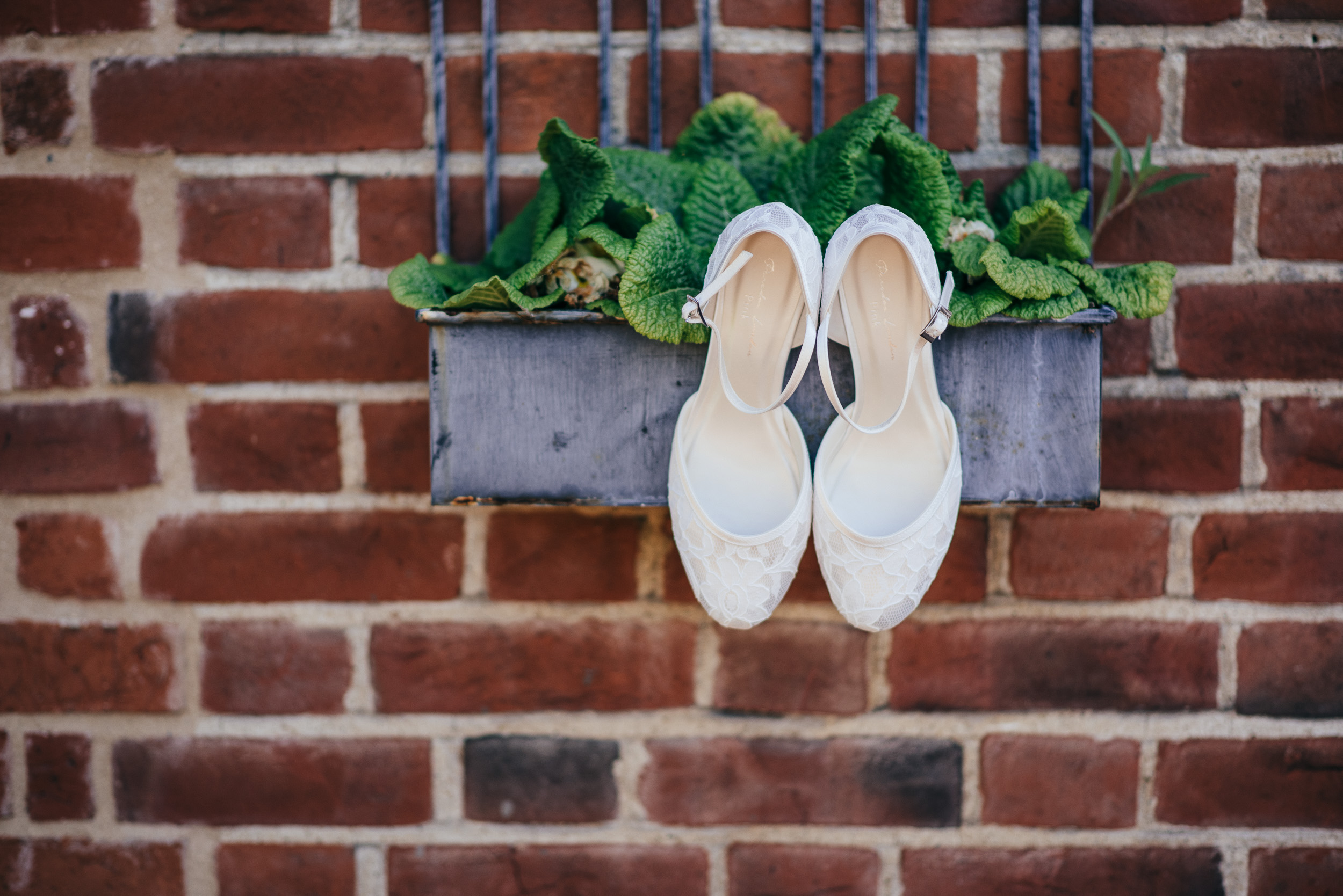 Hanging wedding shoes