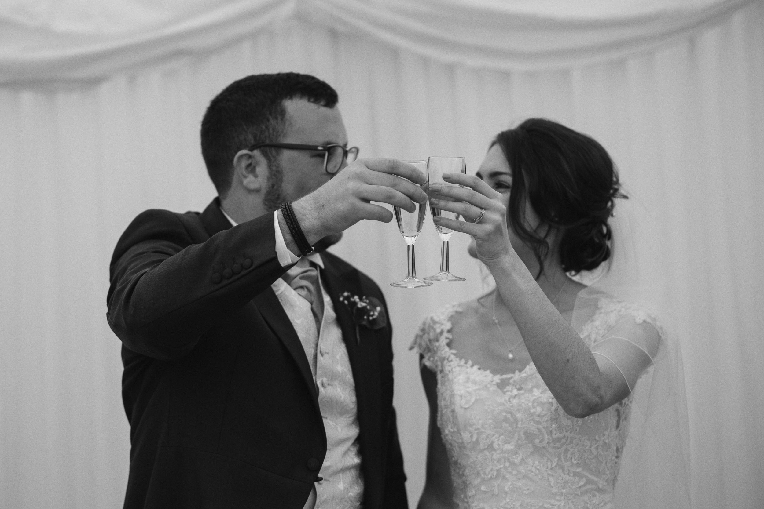 Bride and Groom toast Suffolk