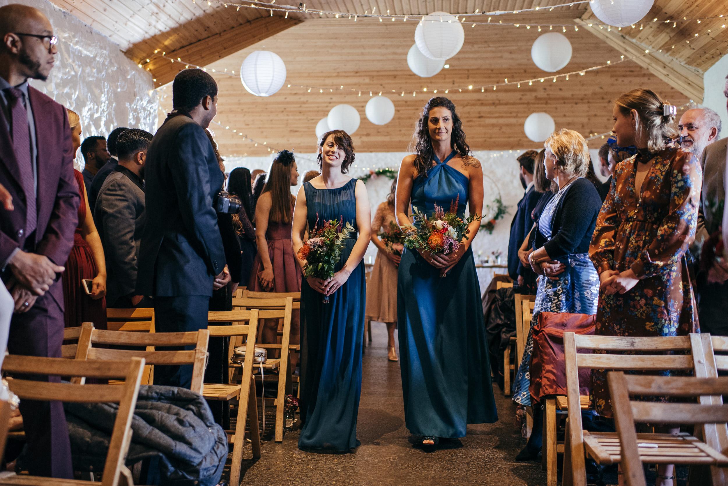 Bridesmaids walking down aisle