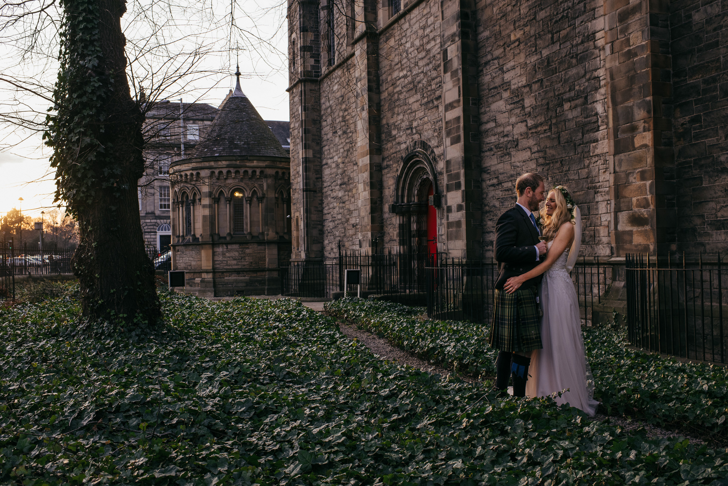 Bride and Groom in beautiful light at Mansfield Traquair