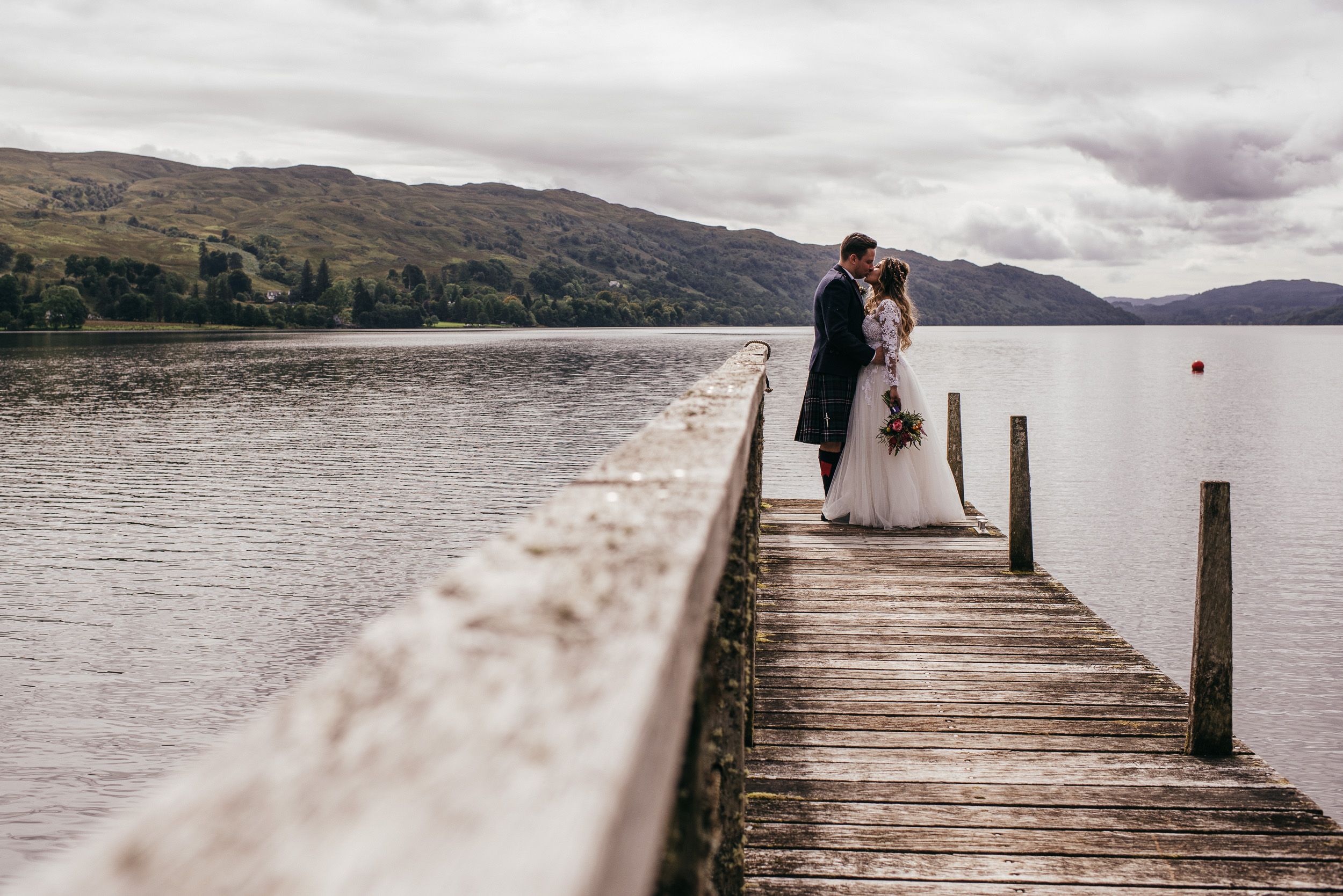Bride and groom on jetty