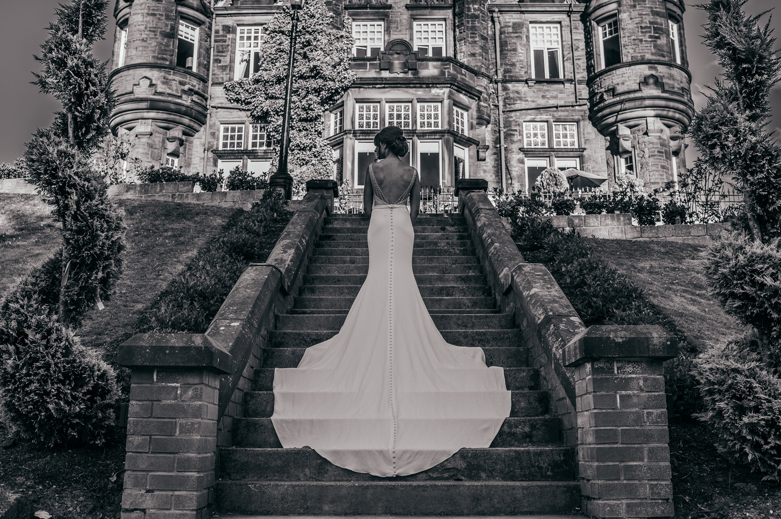 Wedding dress on stairs Sherbrooke Castle