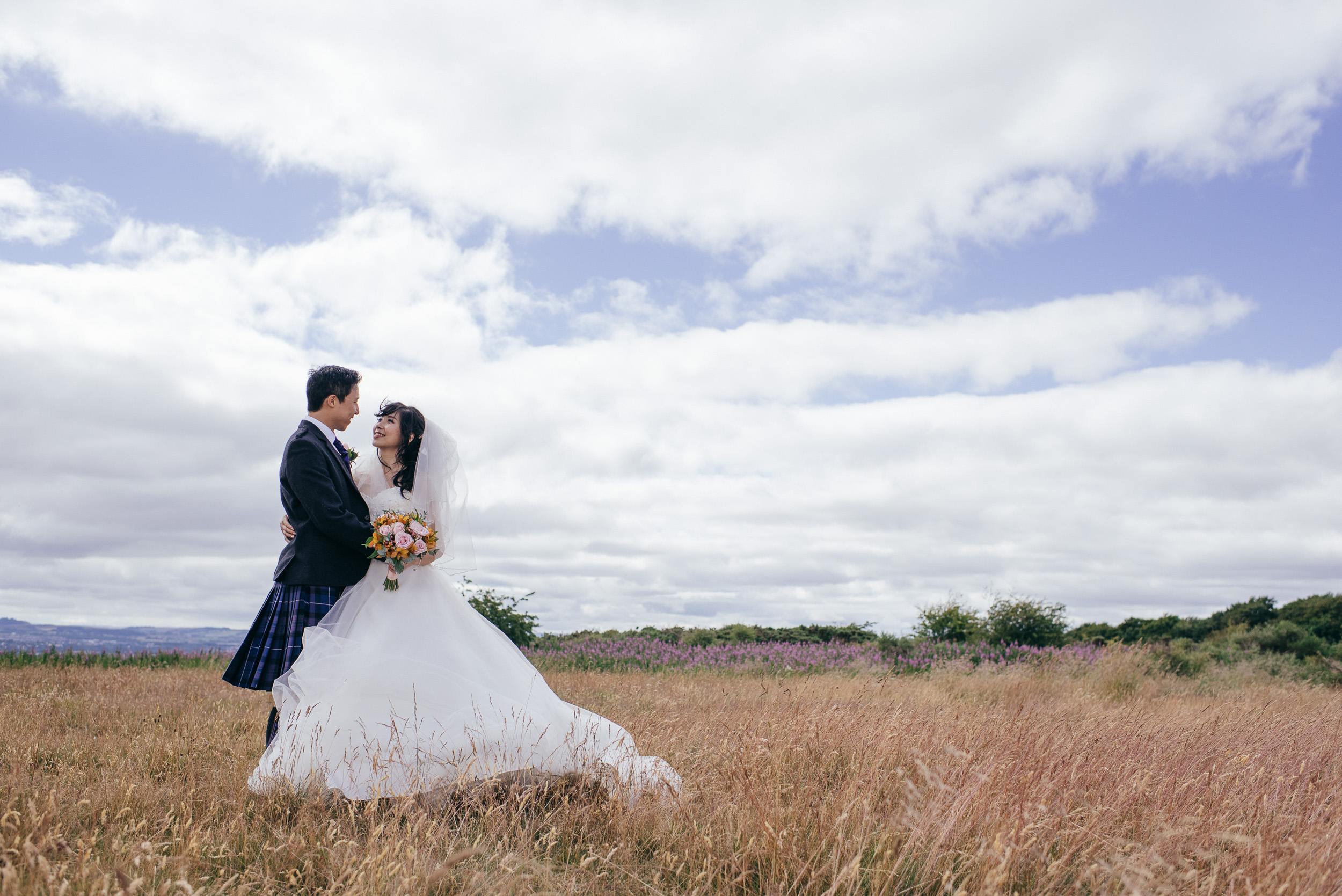 Chinese Scottish wedding in a field
