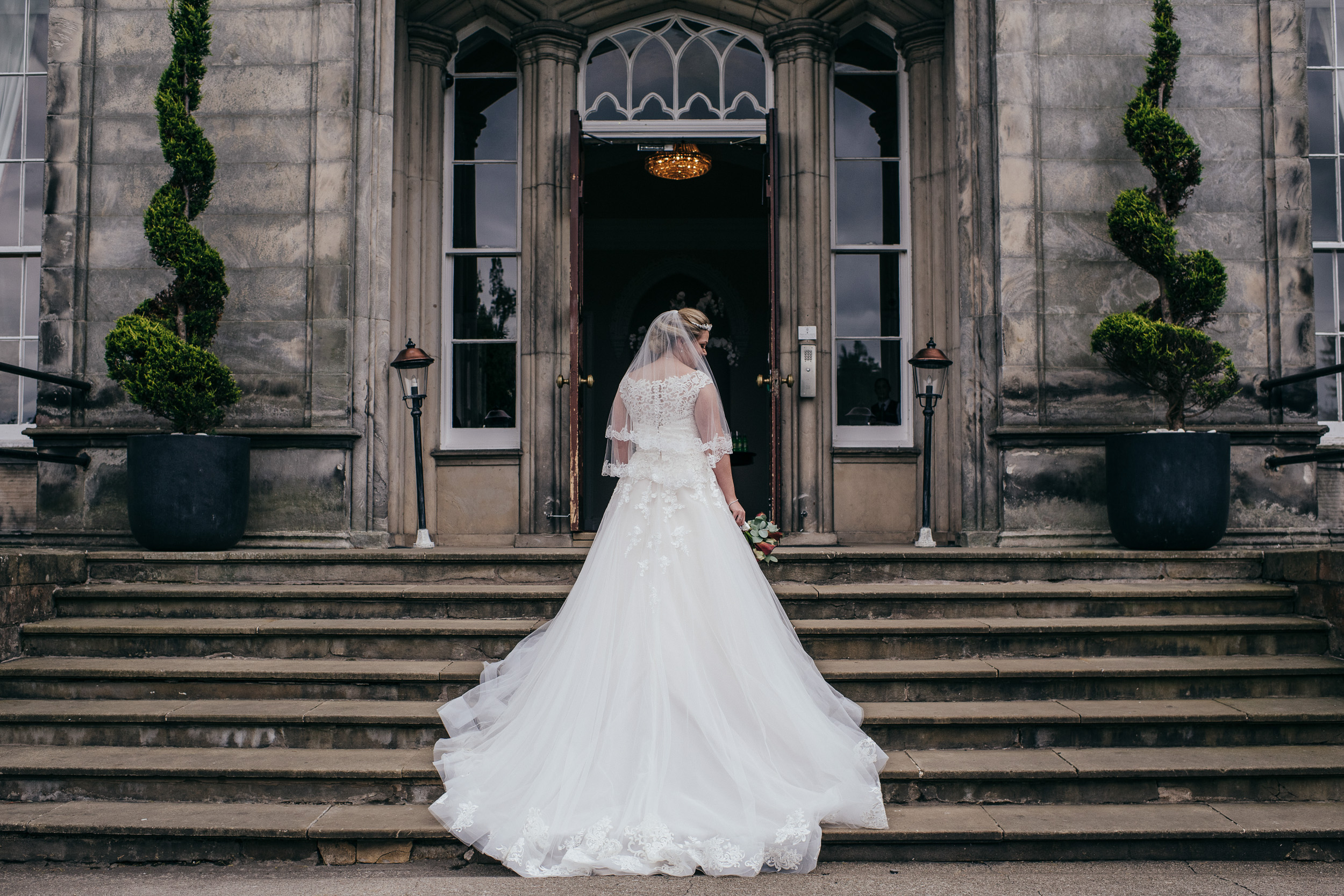 Back of brides dress on stairs