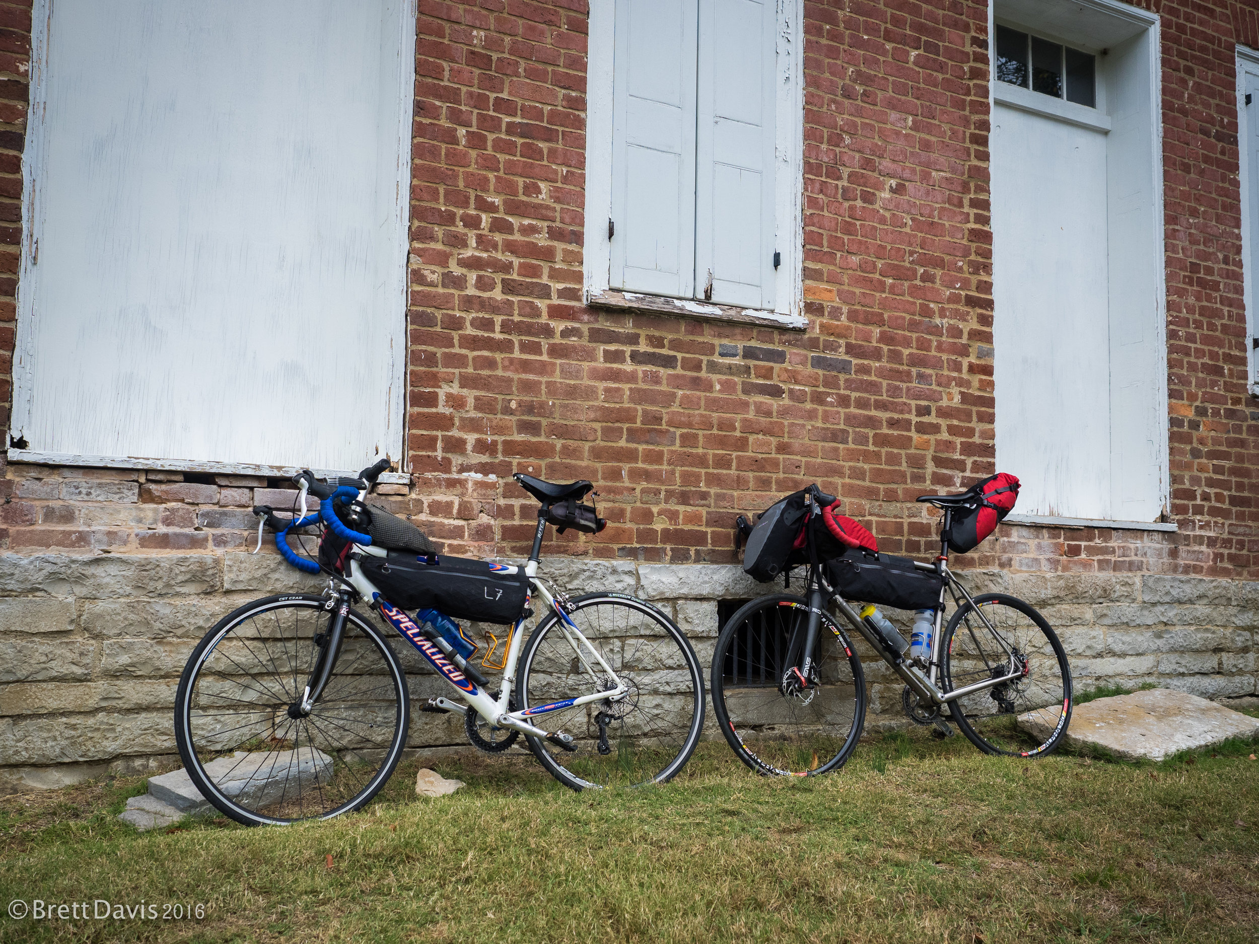 Our trusty steeds getting some rest against one of the old brick walls of the Gordon House.