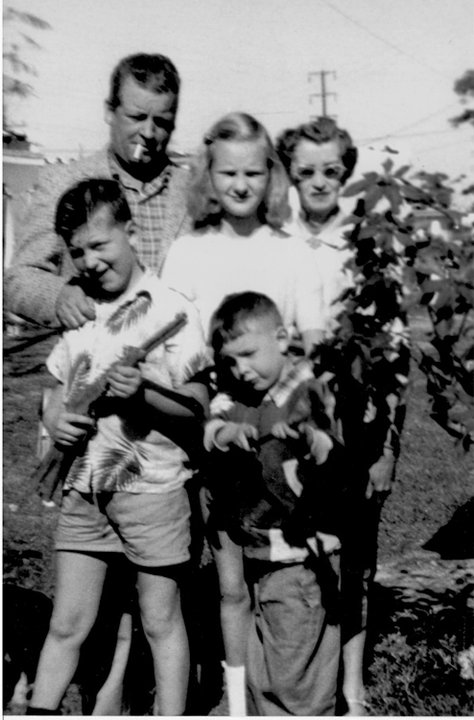 """1956, age 6, before the """"collecting bug"""" caught. With dad Jack, brother John, sister Sue, and Aunt Aggie"""