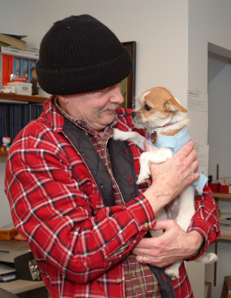 wearing TWO styles of plaid flannel (one insulated!) the day we rescued/adopted Izzy, the tiny monster who rules our home