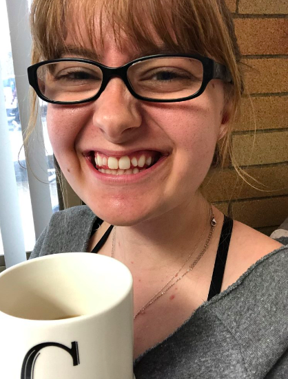 A smiley Claira with her afternoon cup of coffee.