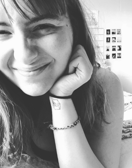 A random black and white selfie (and the drawing on my wrist is a subpar depiction of what a tesserat would look like…)